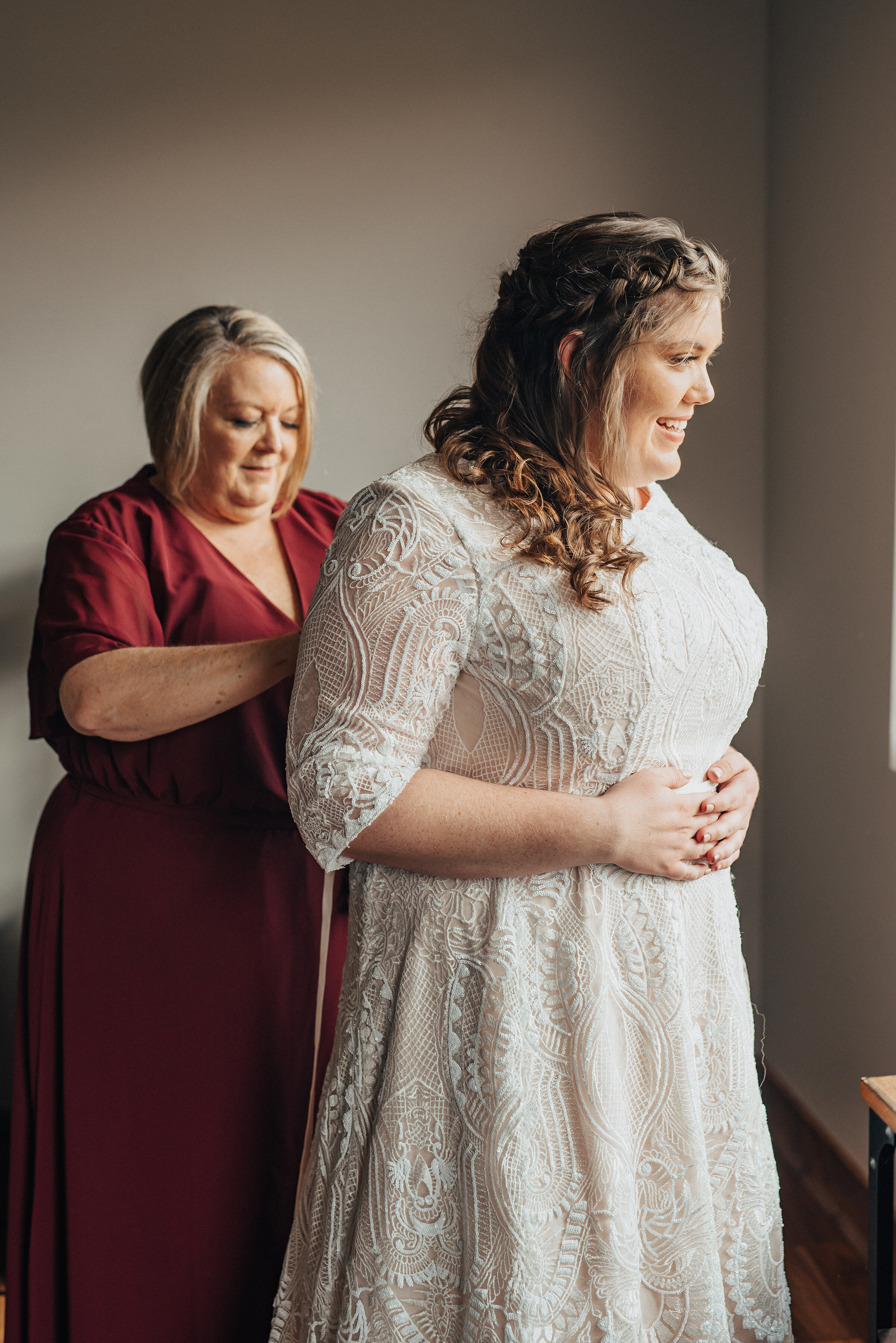 A sweet moment shared by mother and bride on the wedding day in Logan Utah by Kristi Alyse Photography. Mother daughter meaningful moment brides white wedding dress mother of the bride dress inspo braided bride hairstyle wedding day Kristi Alyse wedding photographer norther Utah wedding logan Utah bride #weddinginspo #loganutah #brideandgroom #utahbride #utahweddingphotographer #meaningfulmoment #weddingphotography #northernutahwedding #weddinghairstyles #weddingday #bridals