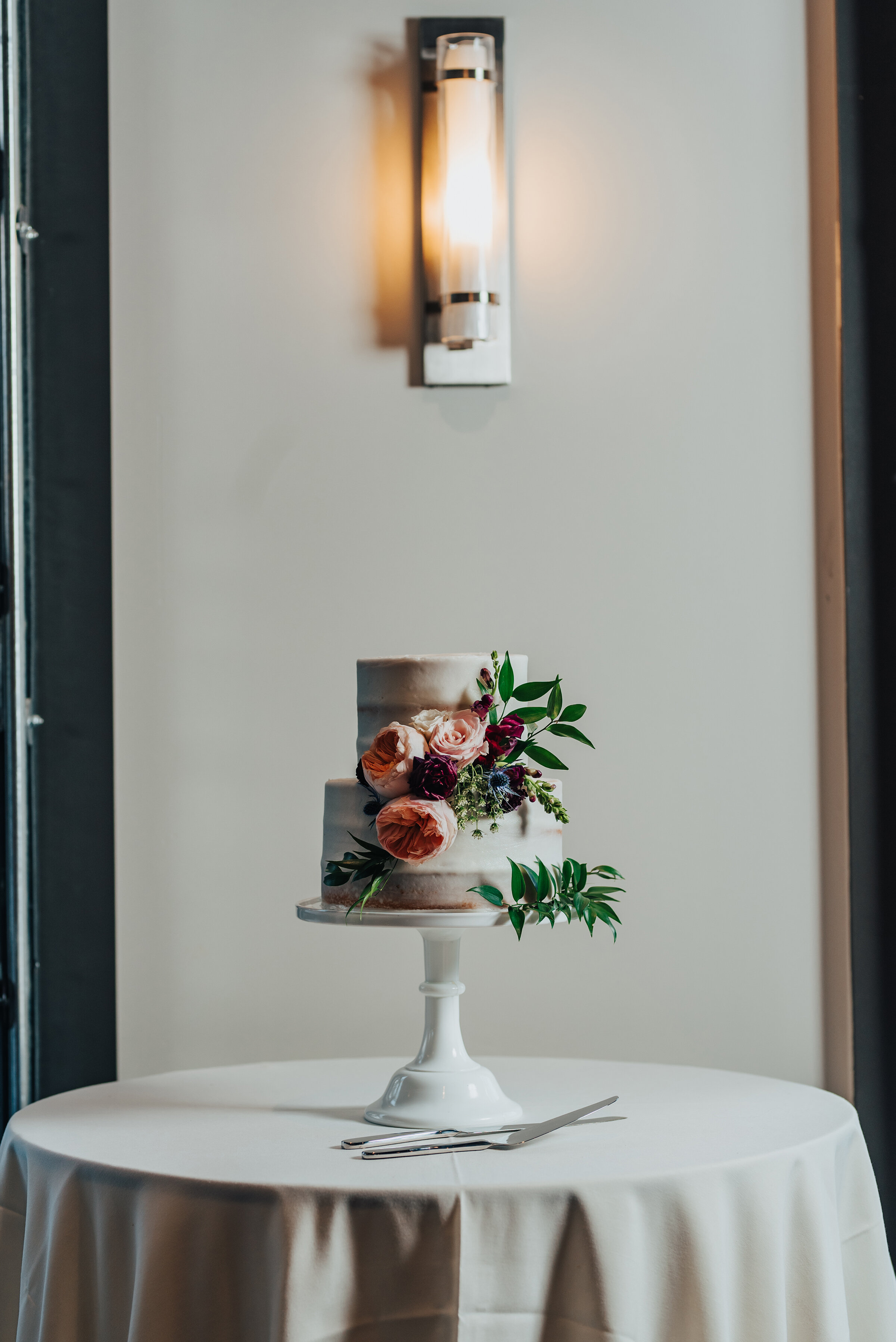Beautiful floral and nude wedding cake shot in Logan, Utah shot by Kristi Alyse Photography. Vanilla nude cake floral arrangement wedding cake quality photos Kristi Alyse cake traditions simple details bride and grooms cake #weddinginspo #loganutah #brideandgroom #utahbride #utahweddingphotographer #meaningfulmoment #weddingphotography #northernutahwedding #weddinghairstyles #weddingday #bridals