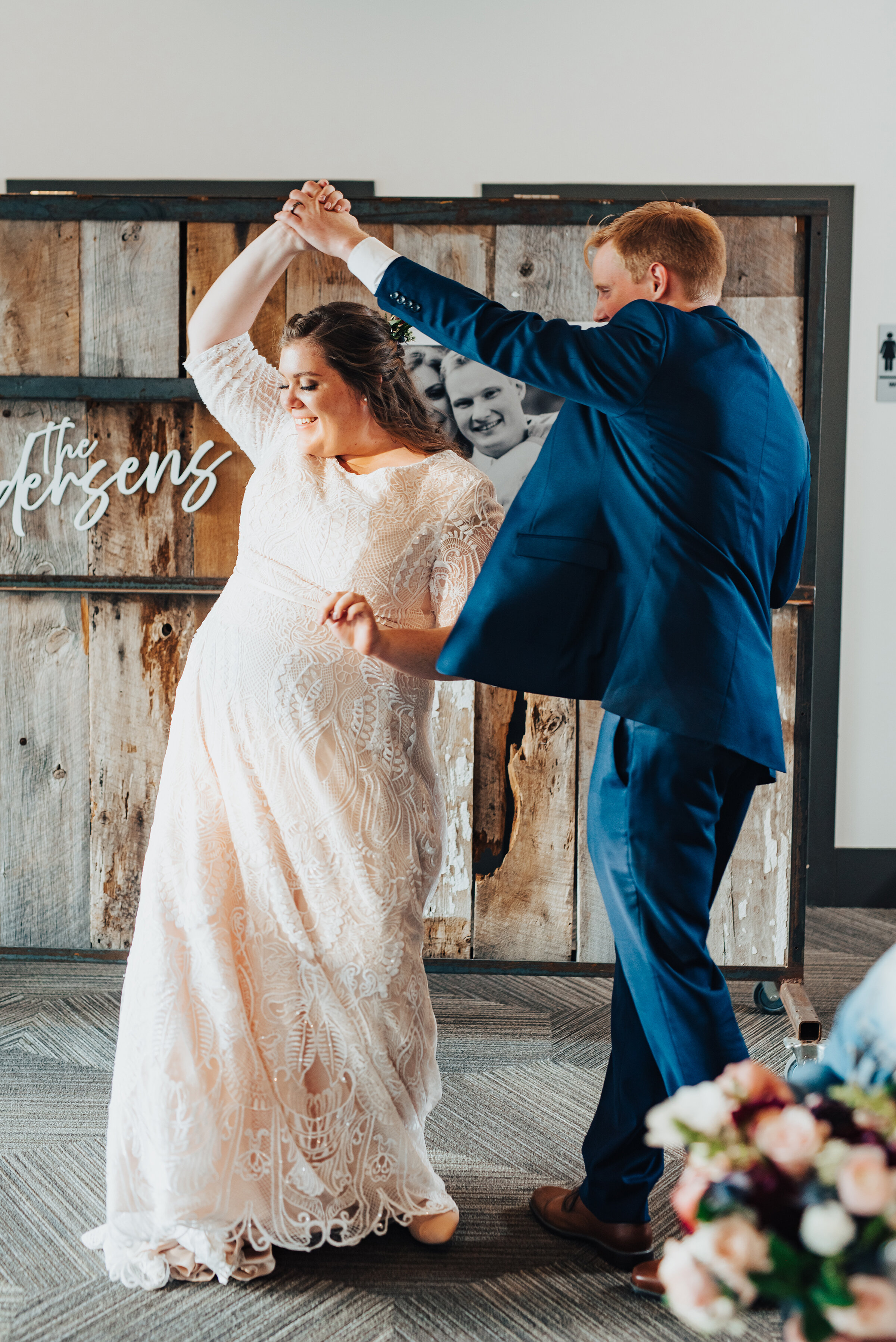 Tender moment of the bride and groom dancing by Kristi Alyse Photography in northern Utah. First dance meaningful moments bride and groom lace wedding dress blue grooms suit wedding décor inspo logan Utah wedding day photography Kristi Alyse #weddinginspo #loganutah #brideandgroom #utahbride #utahweddingphotographer#meaningfulmoment #weddingphotography #northernutahwedding #weddinghairstyles #weddingday #bridals
