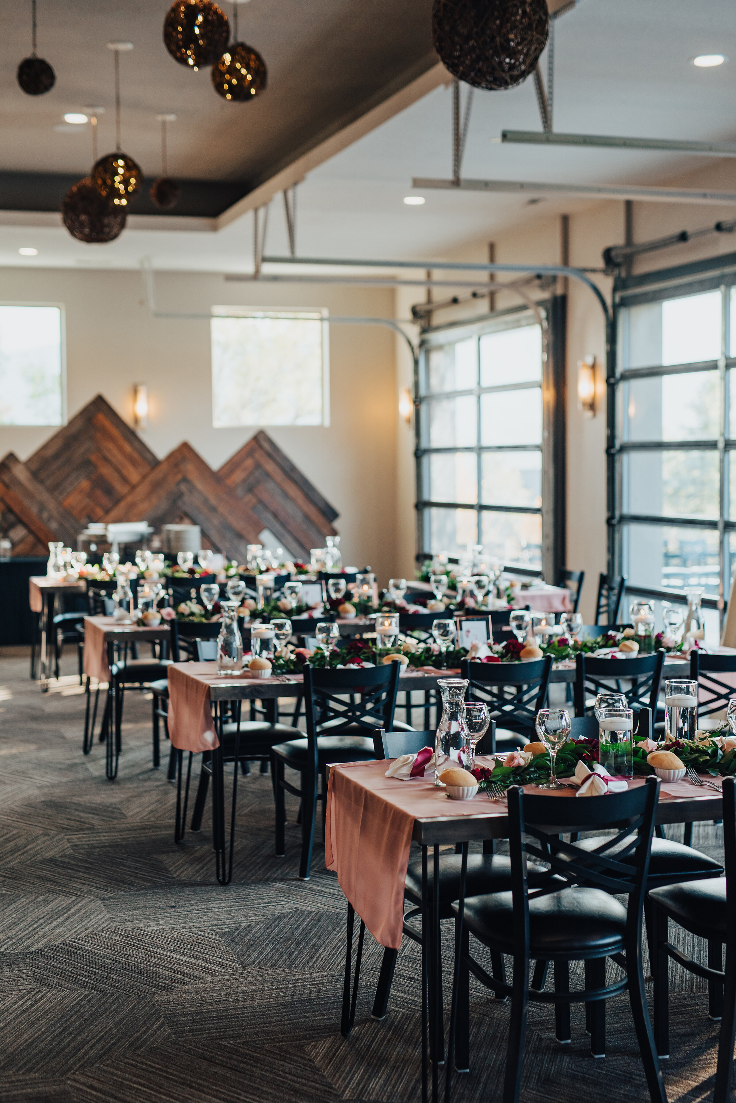 Gorgeous look at the before shot of a wedding luncheon in Logan, Utah by Kristi Alyse Photography. Luncheon table settings rehearsal dinner inspo greenery center pieces wine glasses pink tablecloth wedding day luncheon dinner details for the bride and groom wedding day northern Utah wedding photography Kristi Alyse #weddinginspo #loganutah  #brideandgroom #utahbride #utahweddingphotographer#meaningfulmoment #weddingphotography #northernutahwedding #weddinghairstyles #weddingday #bridals