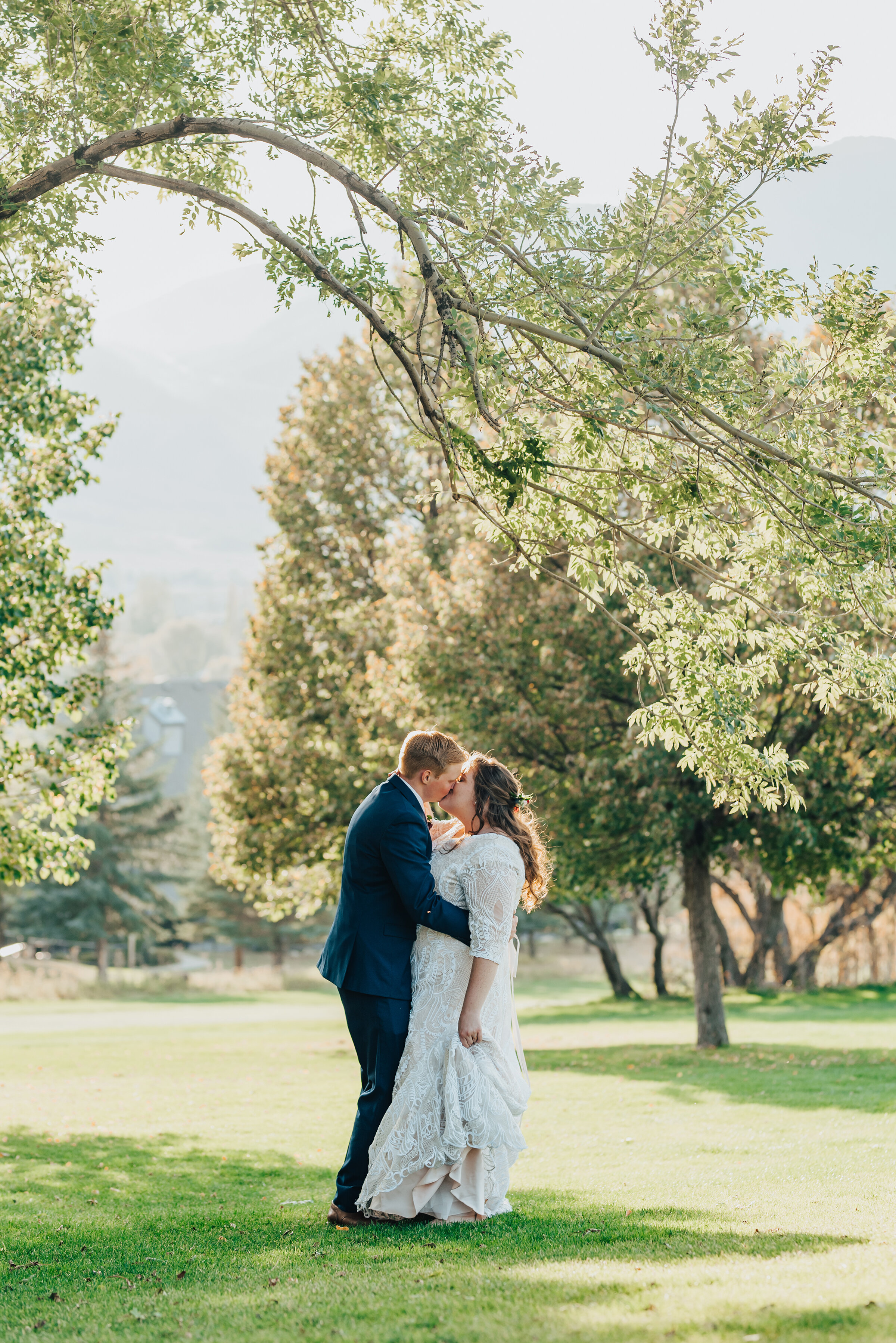 Kristi Alyse Photography captures this special kiss between bride and groom on their wedding day in Logan, Utah. Bride and groom kiss northern Utah wedding day photography inspo white lace wedding dress meaningful moments kiss husband wife logan Utah bride #weddinginspo #loganutah #brideandgroom #utahbride #utahweddingphotographer #meaningfulmoment #weddingphotography #northernutahwedding #weddinghairstyles #weddingday #bridals
