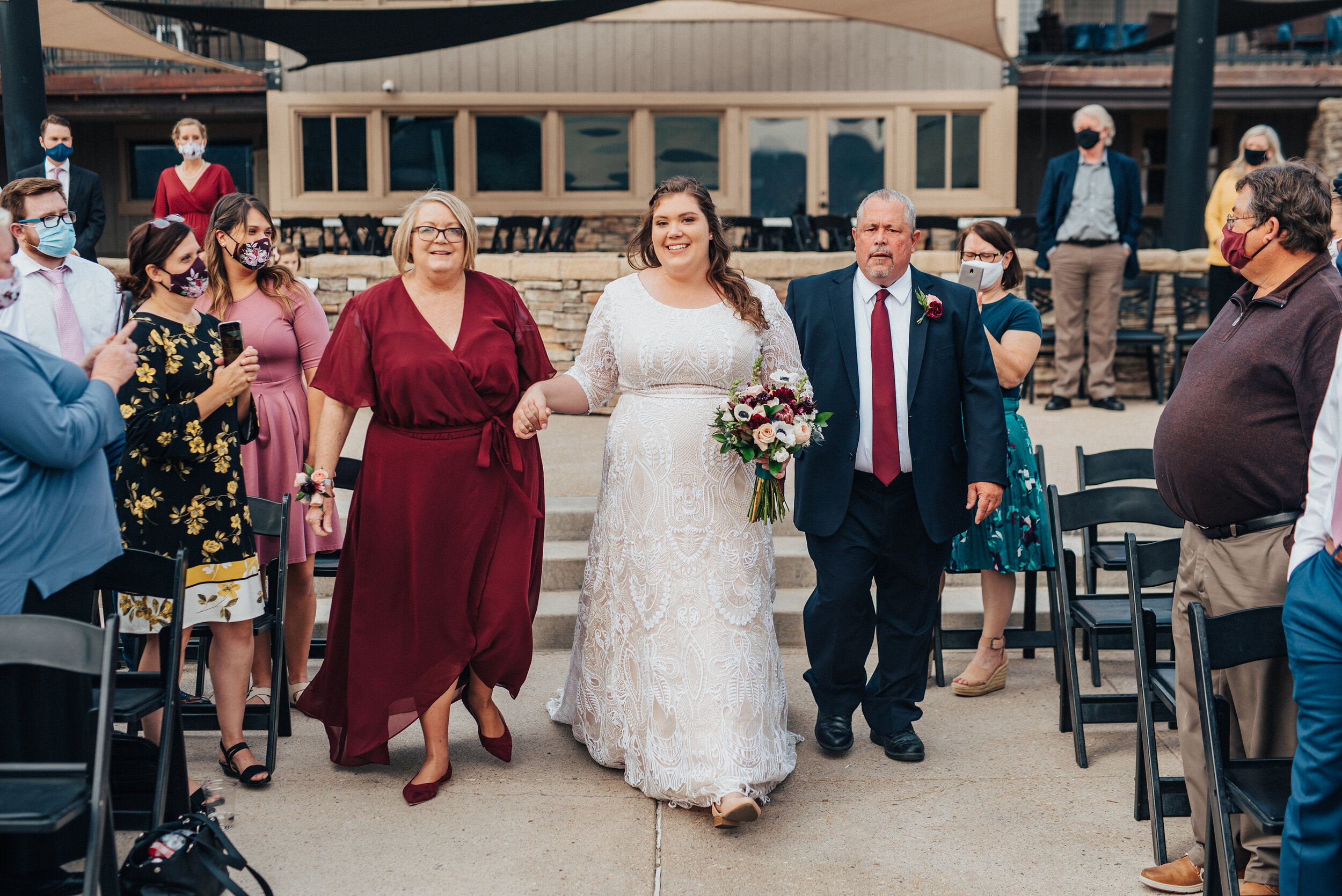 The moment of the bride walking down the aisle captured by Kristi Alyse Photography in northern Utah. Mother and father of the bride walk bride down the aisle meaningful moment quality wedding day photography Kristi Alyse wedding inspiration bride wedding dress lace details #weddinginspo #loganutah #brideandgroom #utahbride #utahweddingphotographer #meaningfulmoment #weddingphotography #northernutahwedding #weddinghairstyles #weddingday #bridals