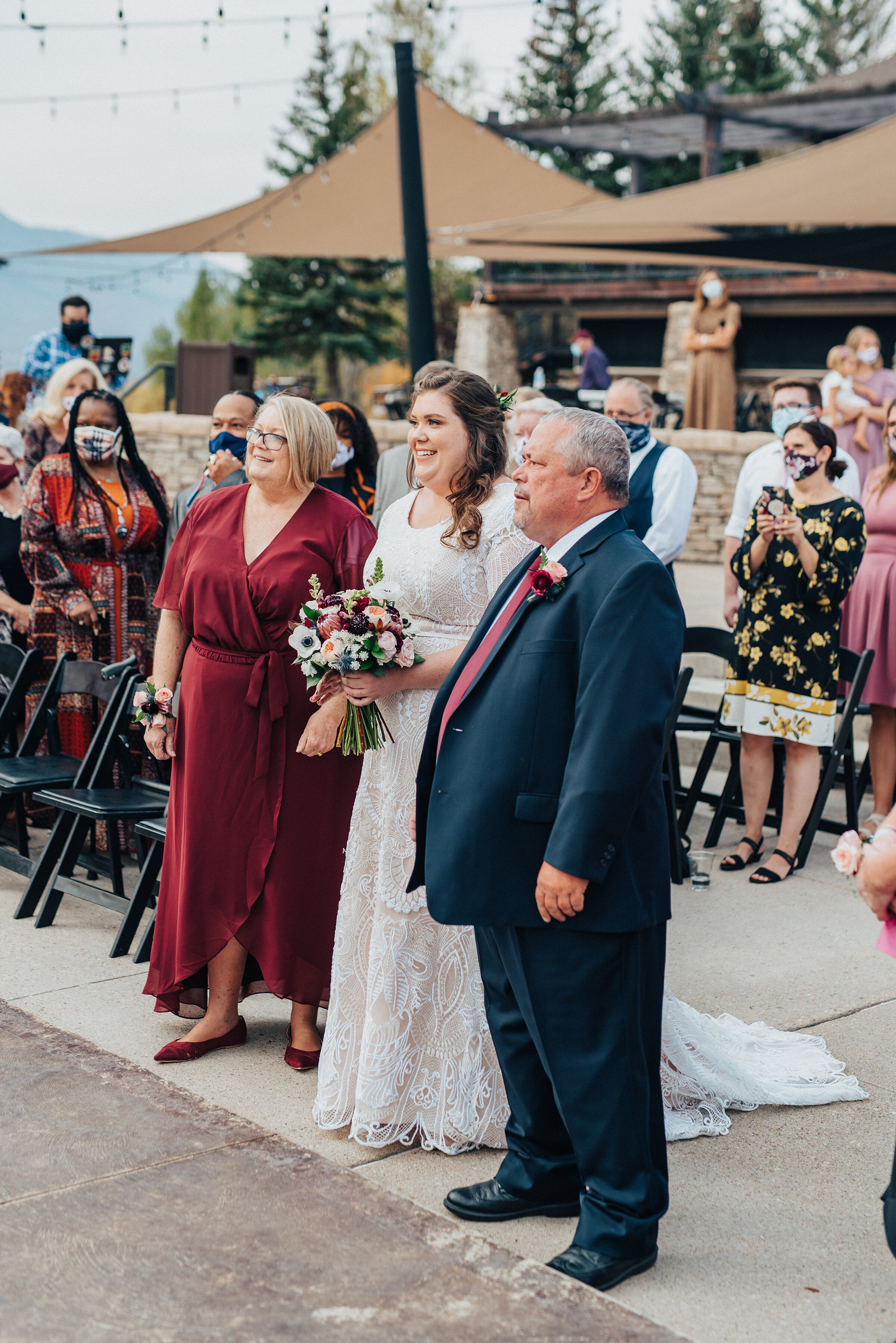 Beautiful bride with her parents before the wedding ceremony in northern Utah captured by Kristi Alyse Photography. Wedding day photography captures family mother daughter father wedding ceremony logan Utah bride meaningful moments classy floral bouquet quality images #weddinginspo #loganutah #brideandgroom #utahbride#utahweddingphotographer #meaningfulmoment #weddingphotography #northernutahwedding #weddinghairstyles #weddingday #bridals