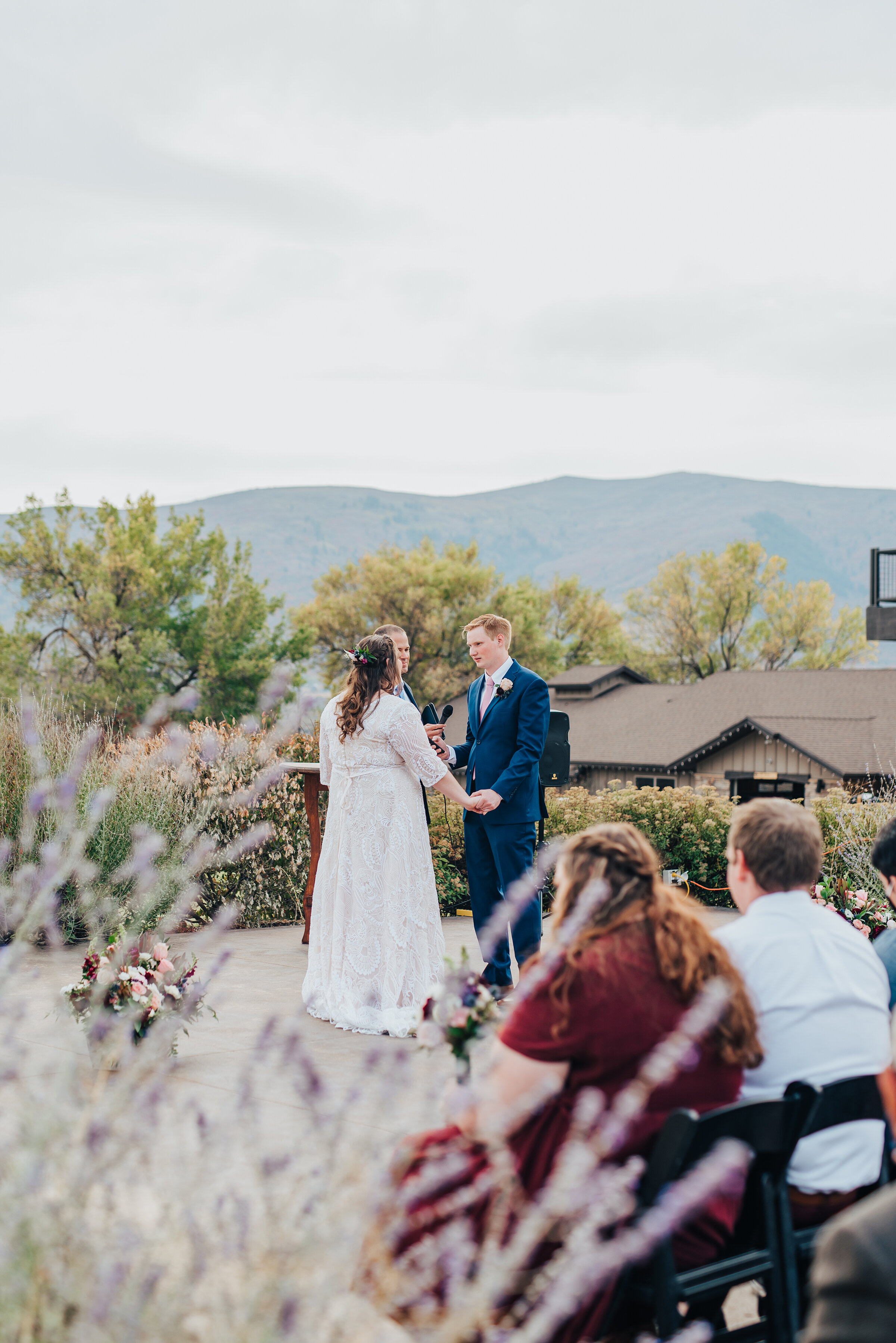 Bride and groom holding hands during their beautiful ceremony in northern Utah shot by Kristi Alyse Photography. Meaningful moment in wedding ceremony wedding day photography Utah bride logan Utah mountain background adventure love story I do photograph inspo #weddinginspo #loganutah #brideandgroom #utahbride #utahweddingphotographer #meaningfulmoment #weddingphotography #northernutahwedding #weddinghairstyles #weddingday #bridals