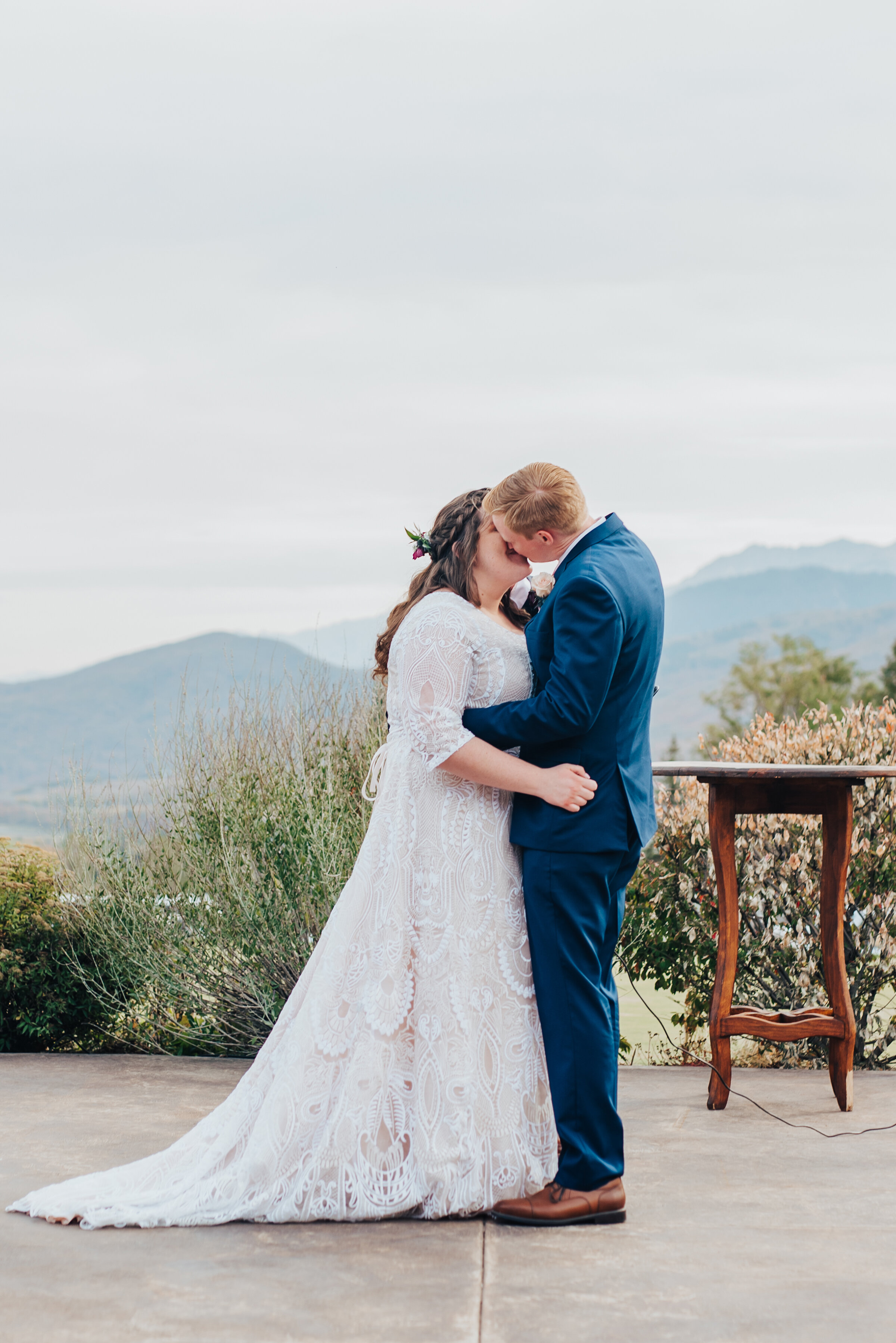 First kiss as husband and wife in the mountains of northern Utah captured by Kristi Alyse photography. First kiss husband and wife bride and groom mountain Logan Utah wedding ceremony location inspiration wedding photography unique meaningful moments captured #weddinginspo #loganutah #brideandgroom #utahbride #utahweddingphotographer #meaningfulmoment #weddingphotography #northernutahwedding #weddinghairstyles #weddingday #bridals