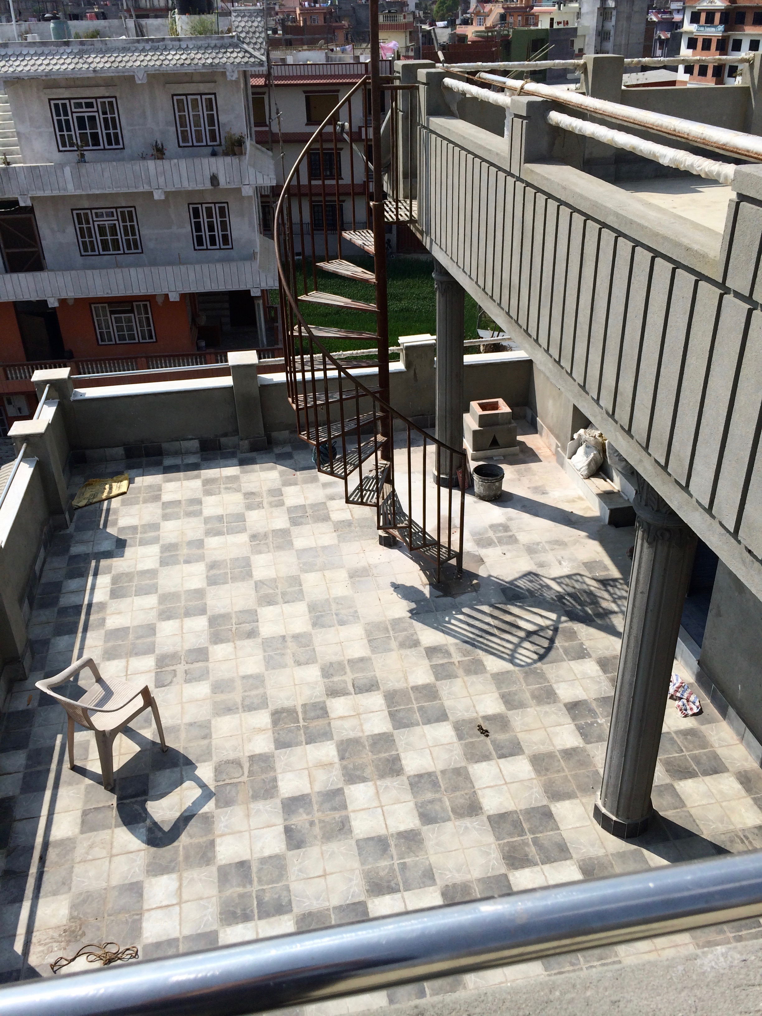 The new rooftop patio before Tika installed her flowers
