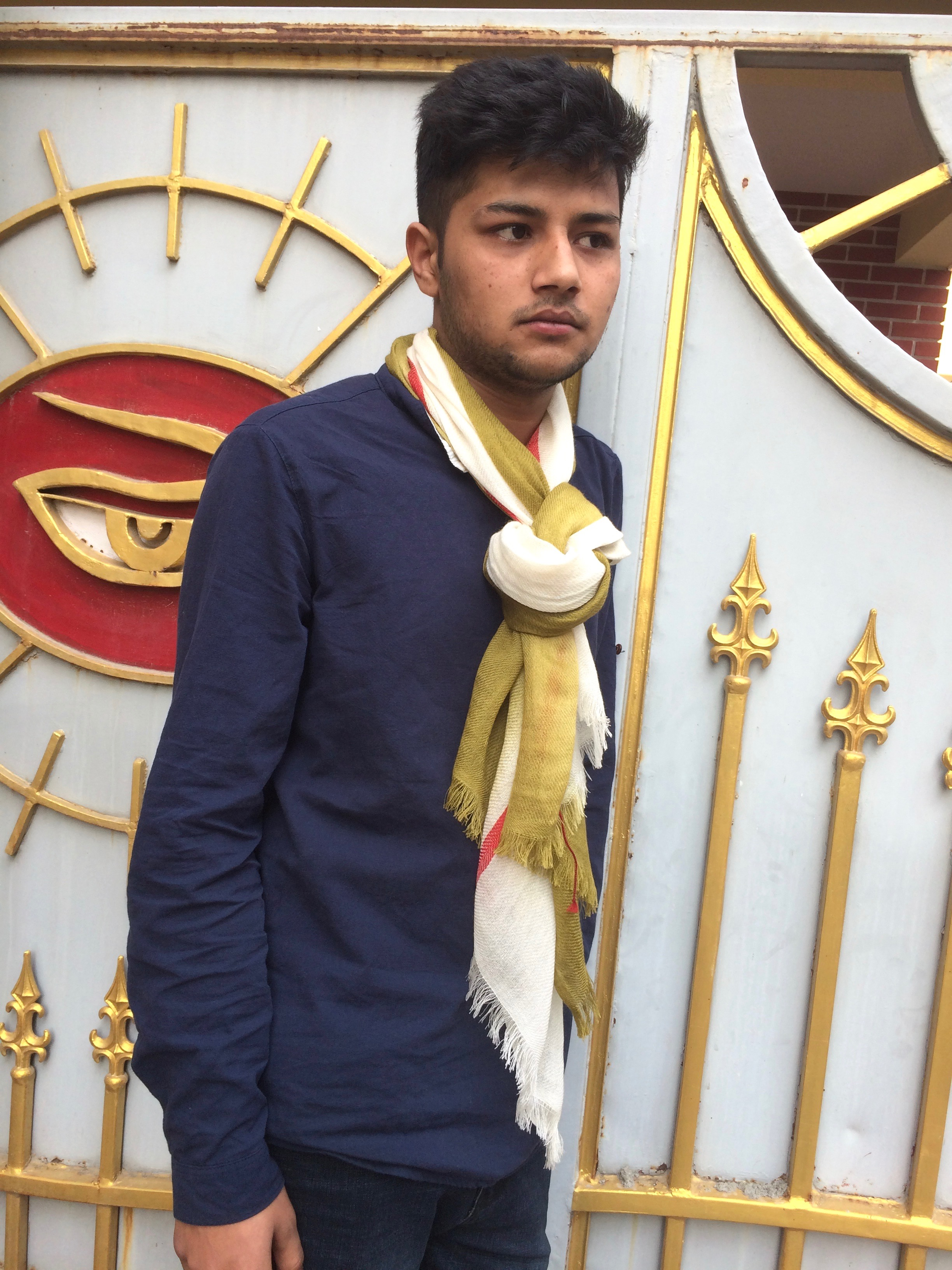 Sushil modelling our Red Line Scarf in front of a fantastic neighborhood gate