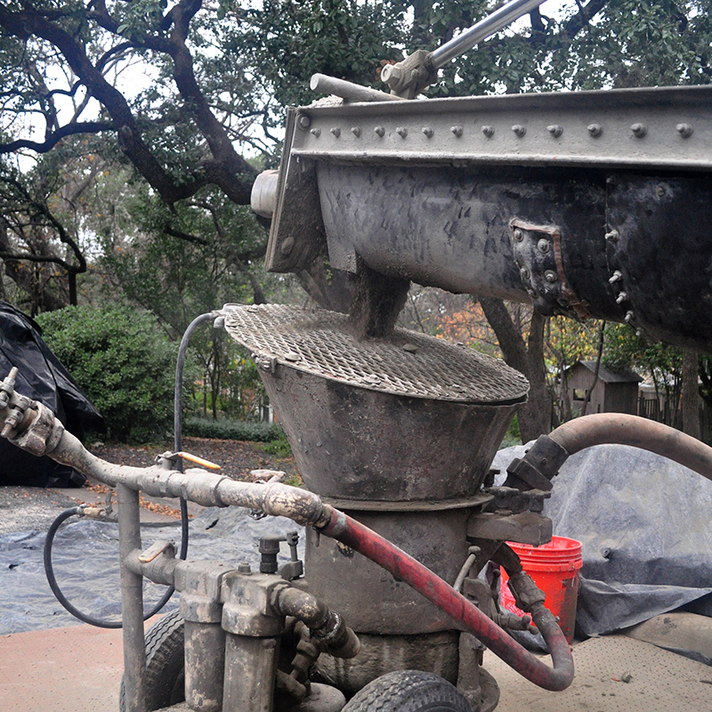 Dry shotcrete mix going into the hopper out on the street.