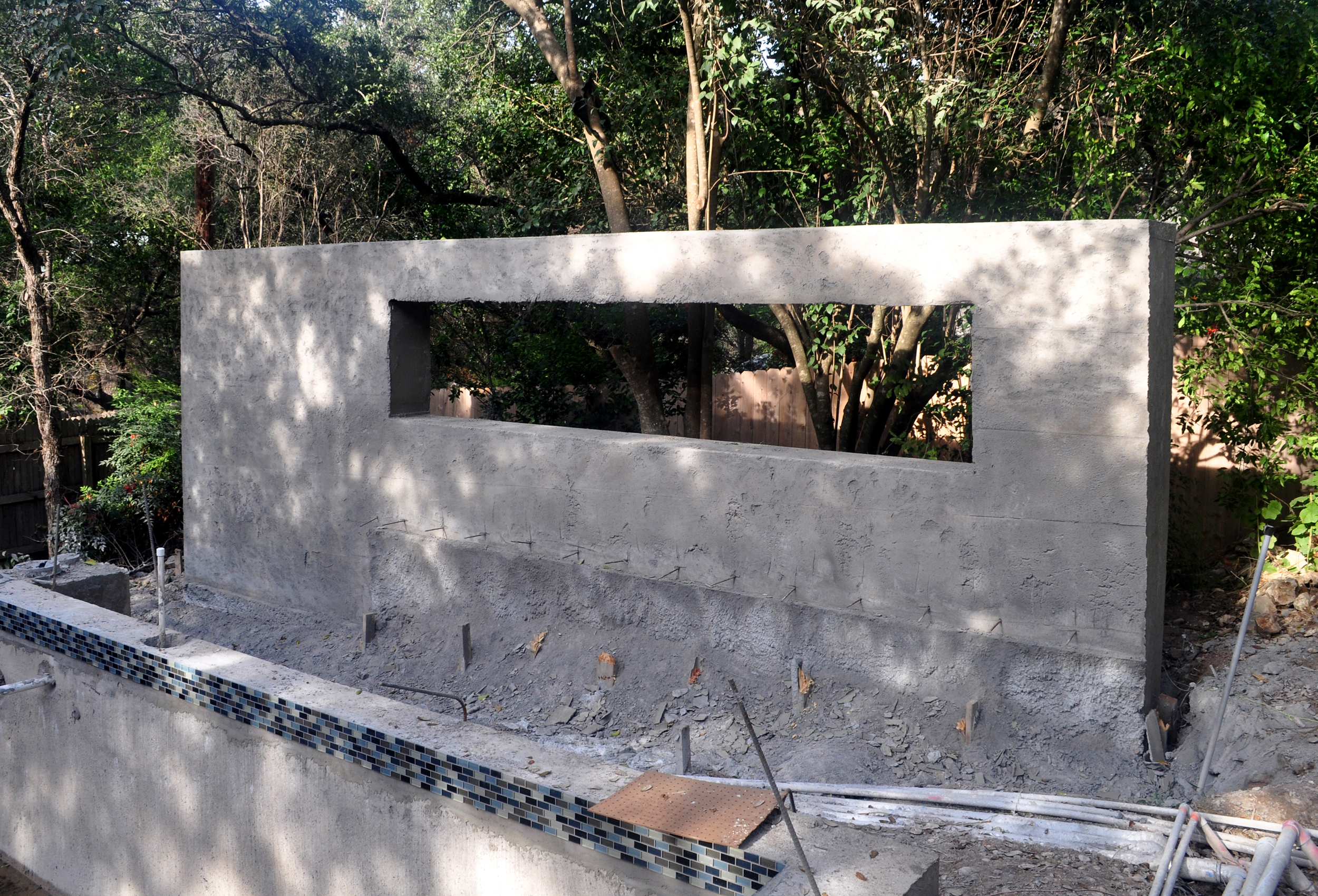 Shotcrete process complete. A more preciseshape (but still rough) is achieved by hand-shaping the concrete while still wet. This wall will receive a finish application of exterior plaster.