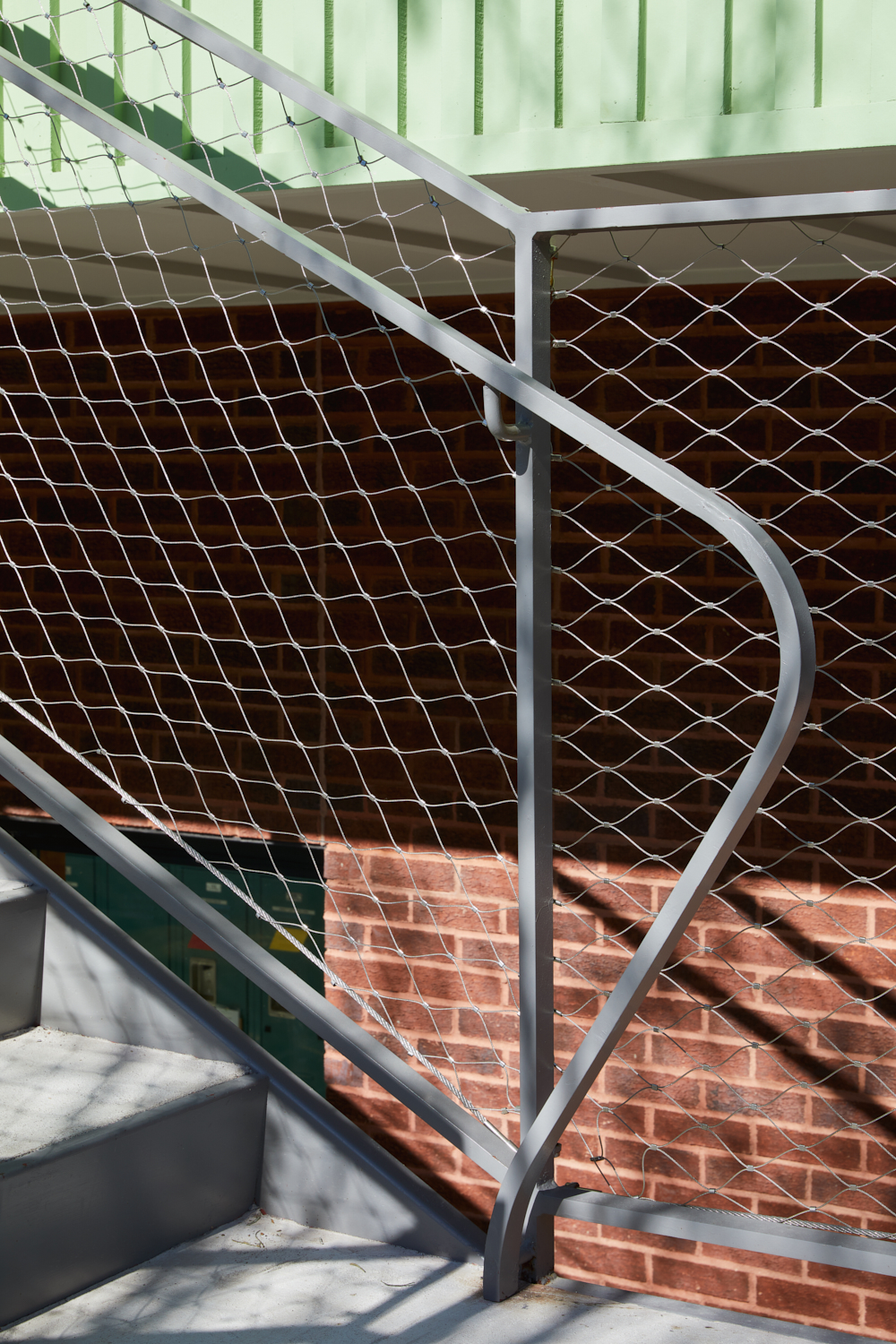 The concrete and steel stair is infilled with a durable stainless steel mesh photo: Leonid Furmansky