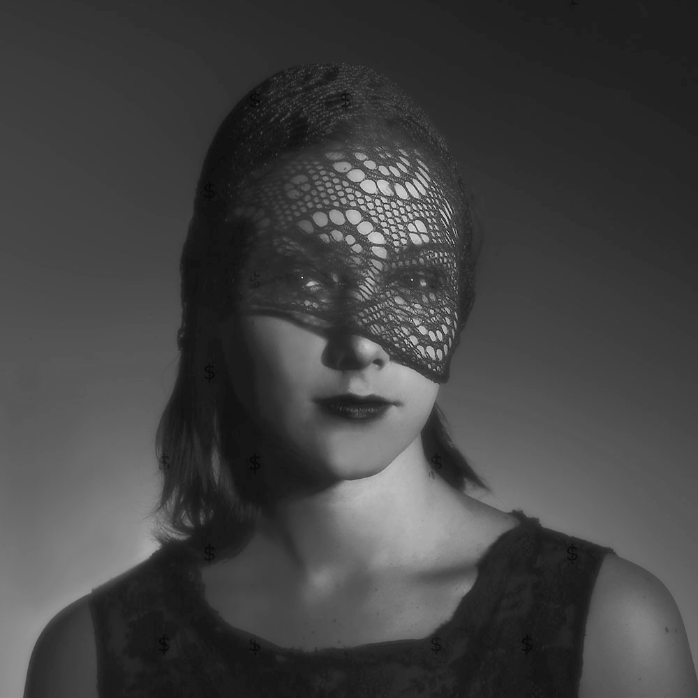 Model in veil.  Old fashioned, Film Noir, Spotlight lighting.  4x5 film for maximum tones and sharpness.