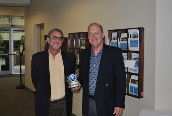 Tam English, Executive Director and CEO, and Scott Strawbridge, Director of Development & Facilities, of the Housing Authority of the City of Fort Lauderdale with their 2012 Smart Growth Excellence award.