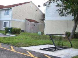 Bicycle lanes were installed on both sides and Glen Apartments installed signature bicycle racks.