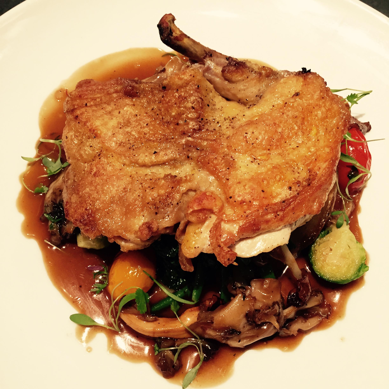 Chantecler Heirloom Roast Chicken with Wild Mushrooms and Seasonal Sautéed Greens.