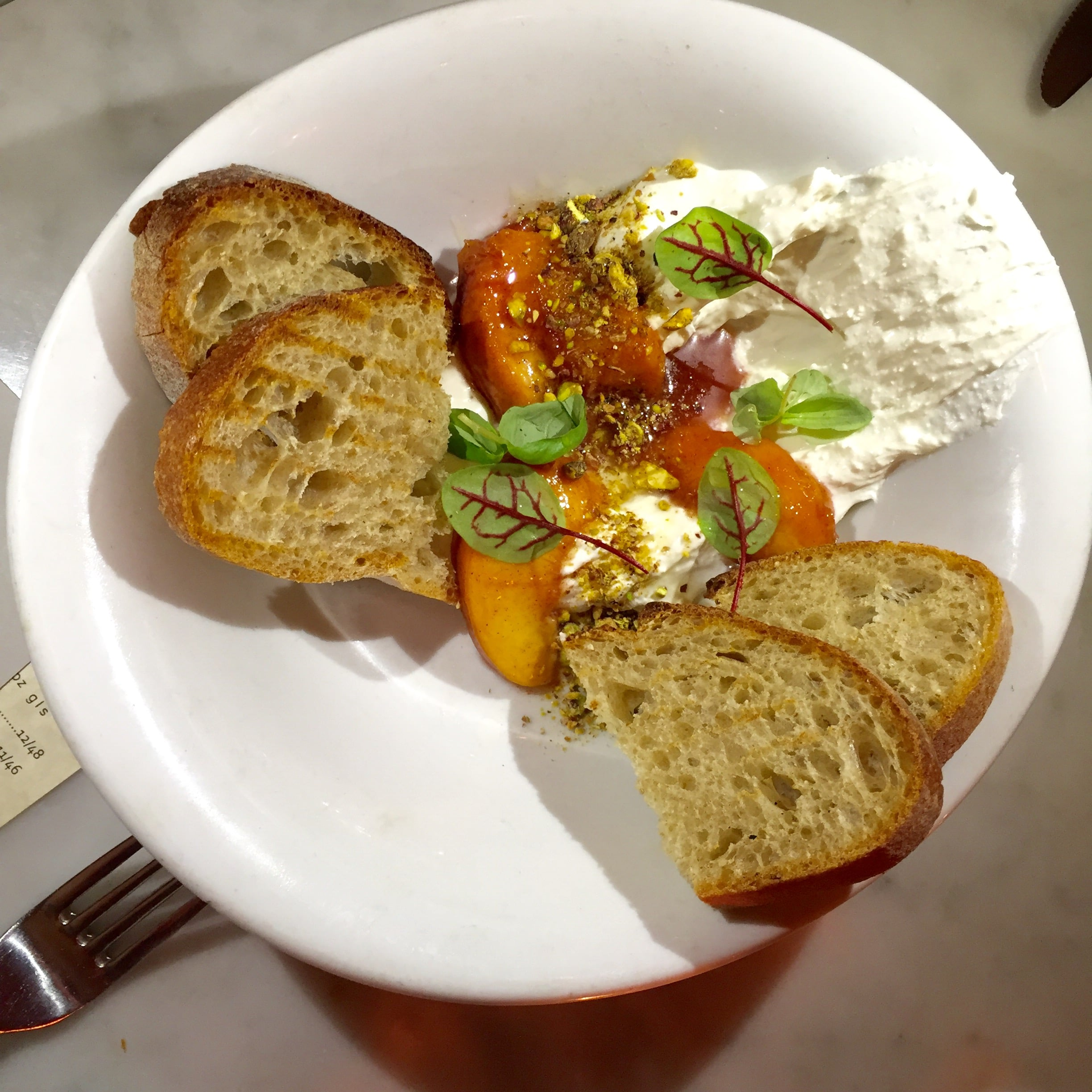 Whipped house made ricotta with spice roasted nectarines,pistachios and grilled sour dough.