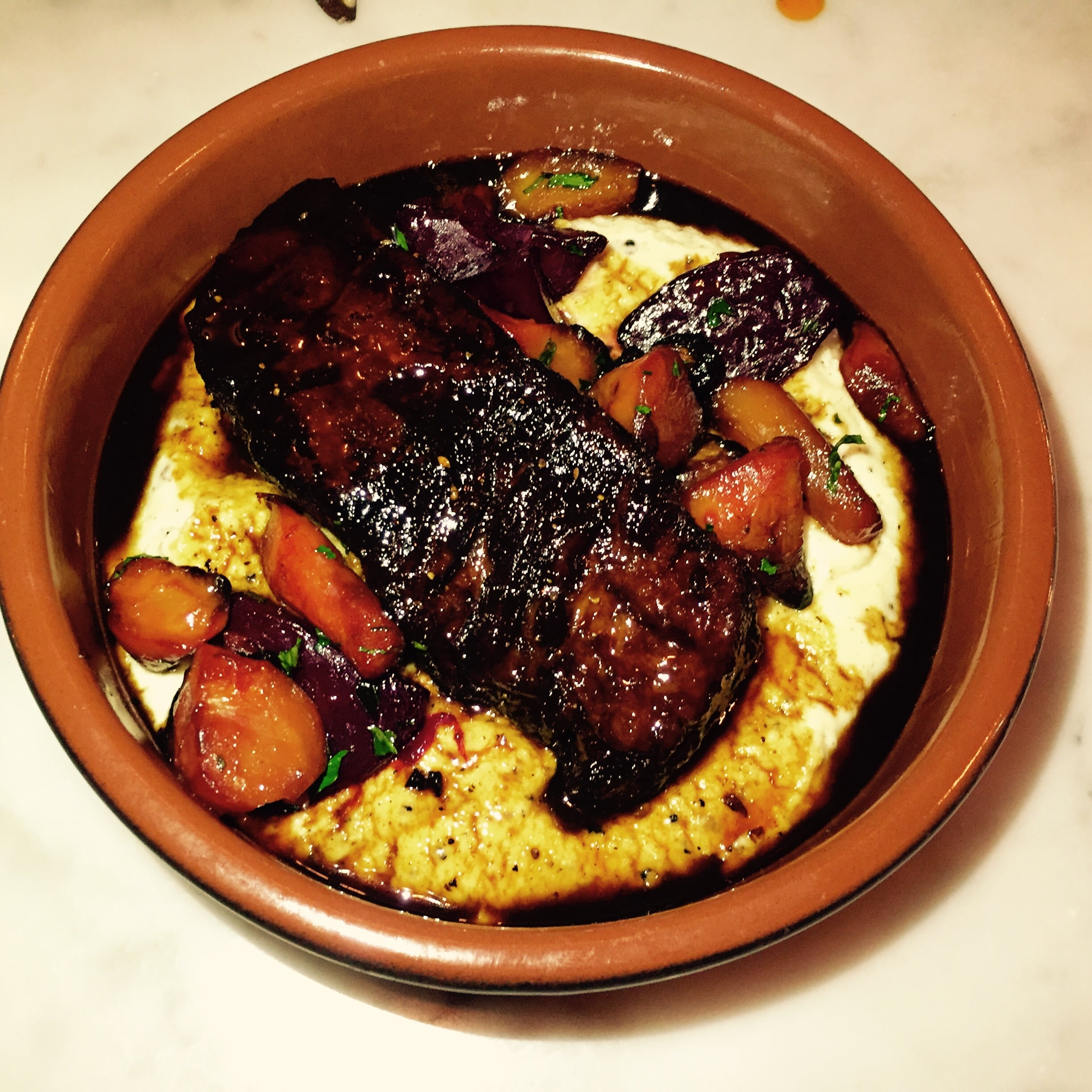 Braised Beef Shortribs with truffles semolina polenta and glazed roots.