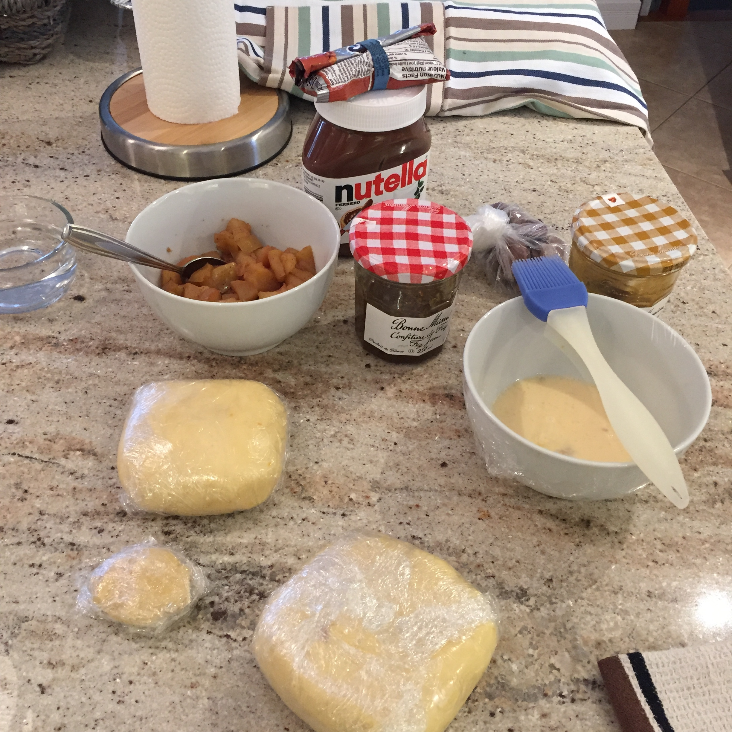 Ingredients for the Hamantaschen: dough and fillings at the ready.