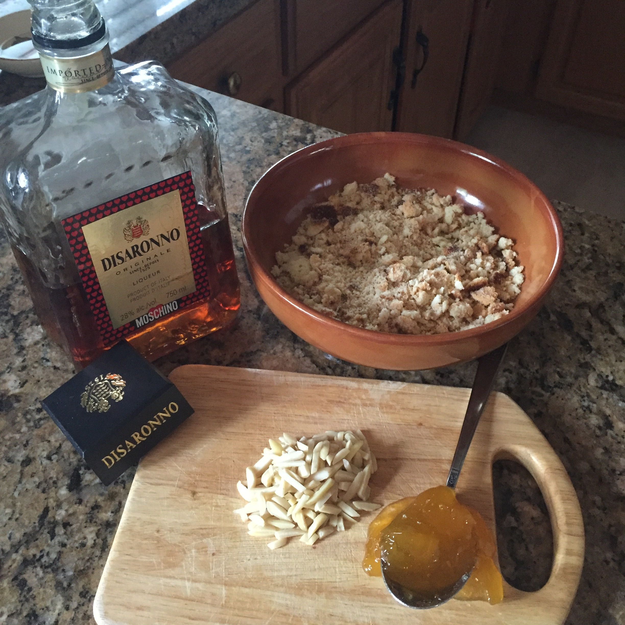Peach Jam, Amaretto and almonds are added to the crumbs.