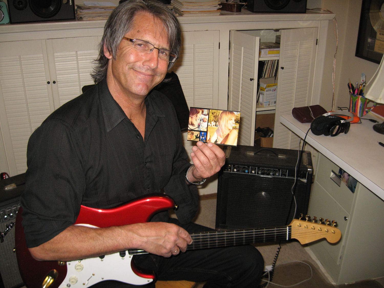 2013, John's studio, holding up a picture of Amanda Lynn Dunn.