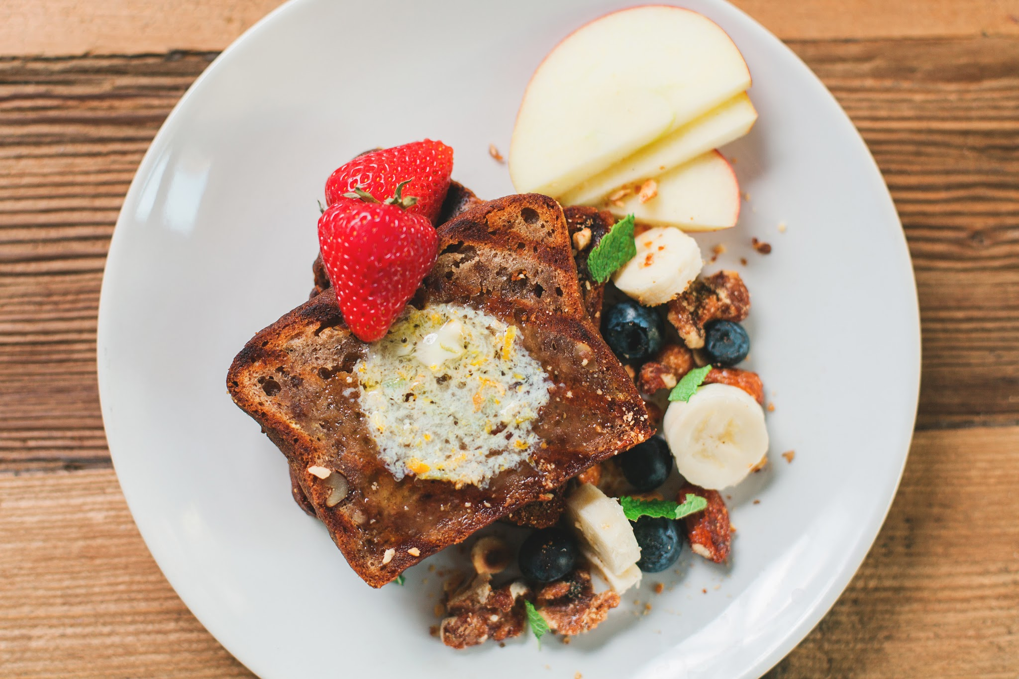 Banana bread, served with fruit, granola and citrus butter....delicious!