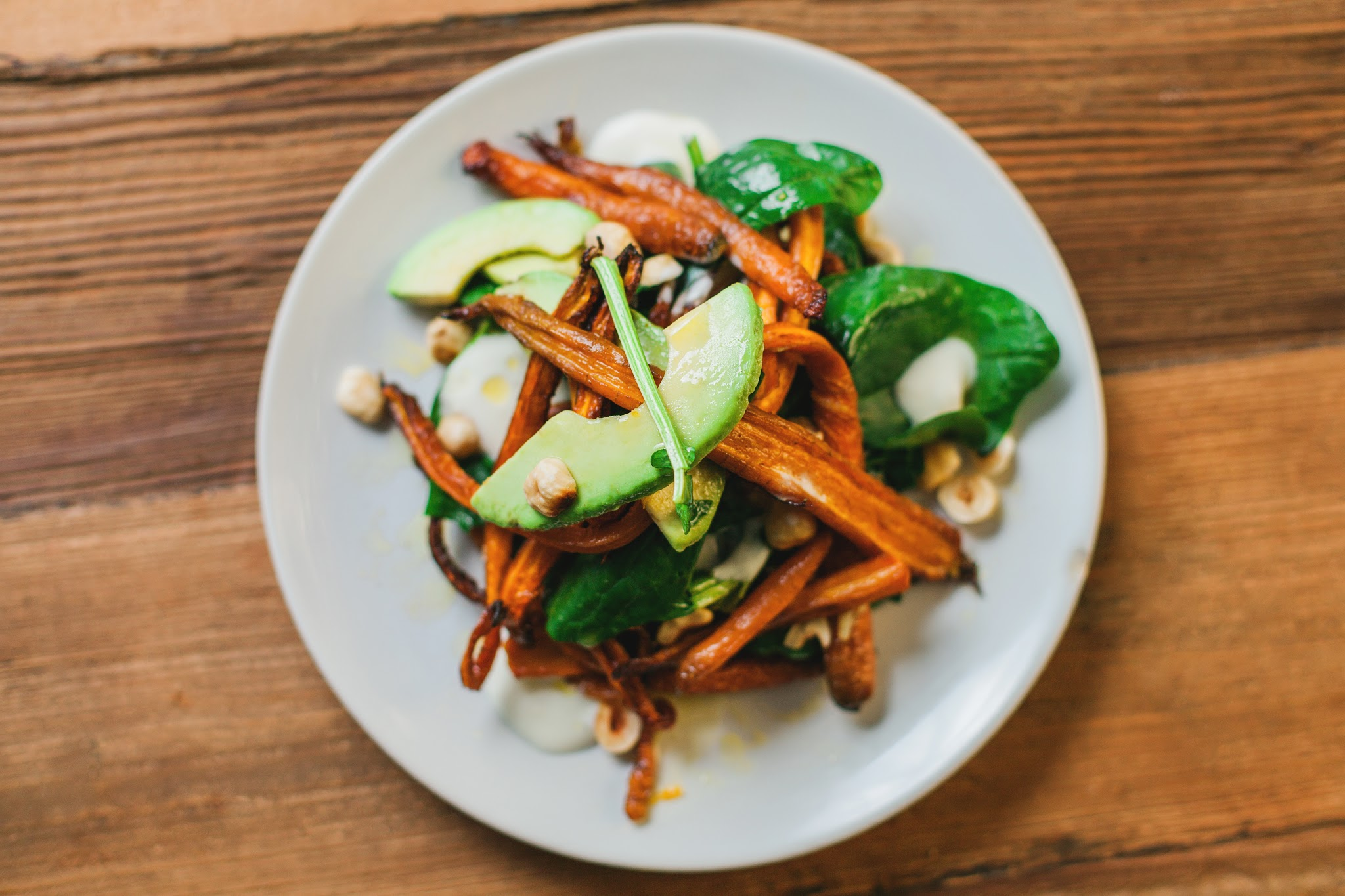 Roasted carrot salad with avocado and hazelnuts...yumm.