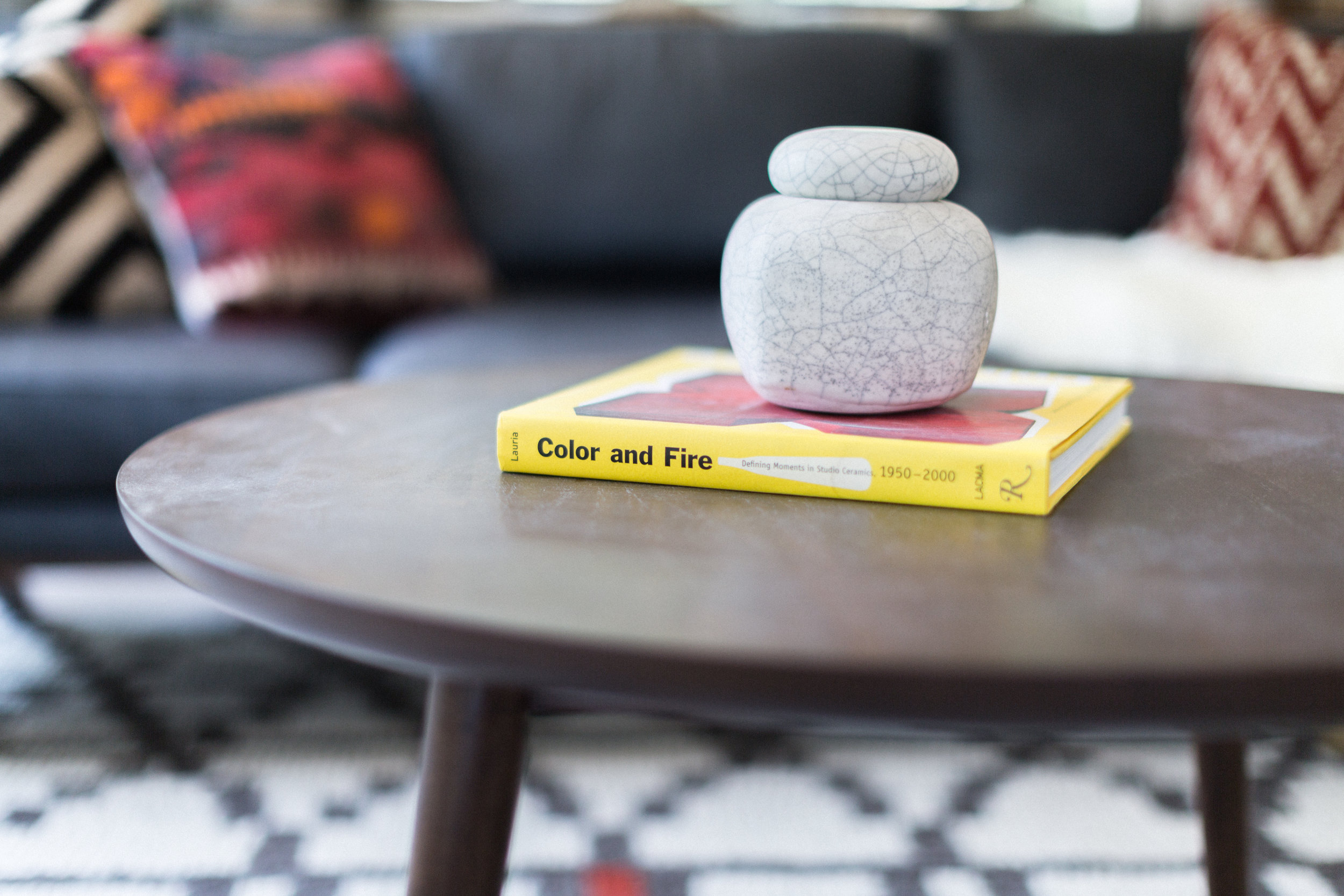 Our second bold accent color - yellow - makes an appearance in the form of a coffee table book. The Mid Century modern coffee table is a World Market find. We shop EVERYWHERE. Yes, you've probably seen us out there.