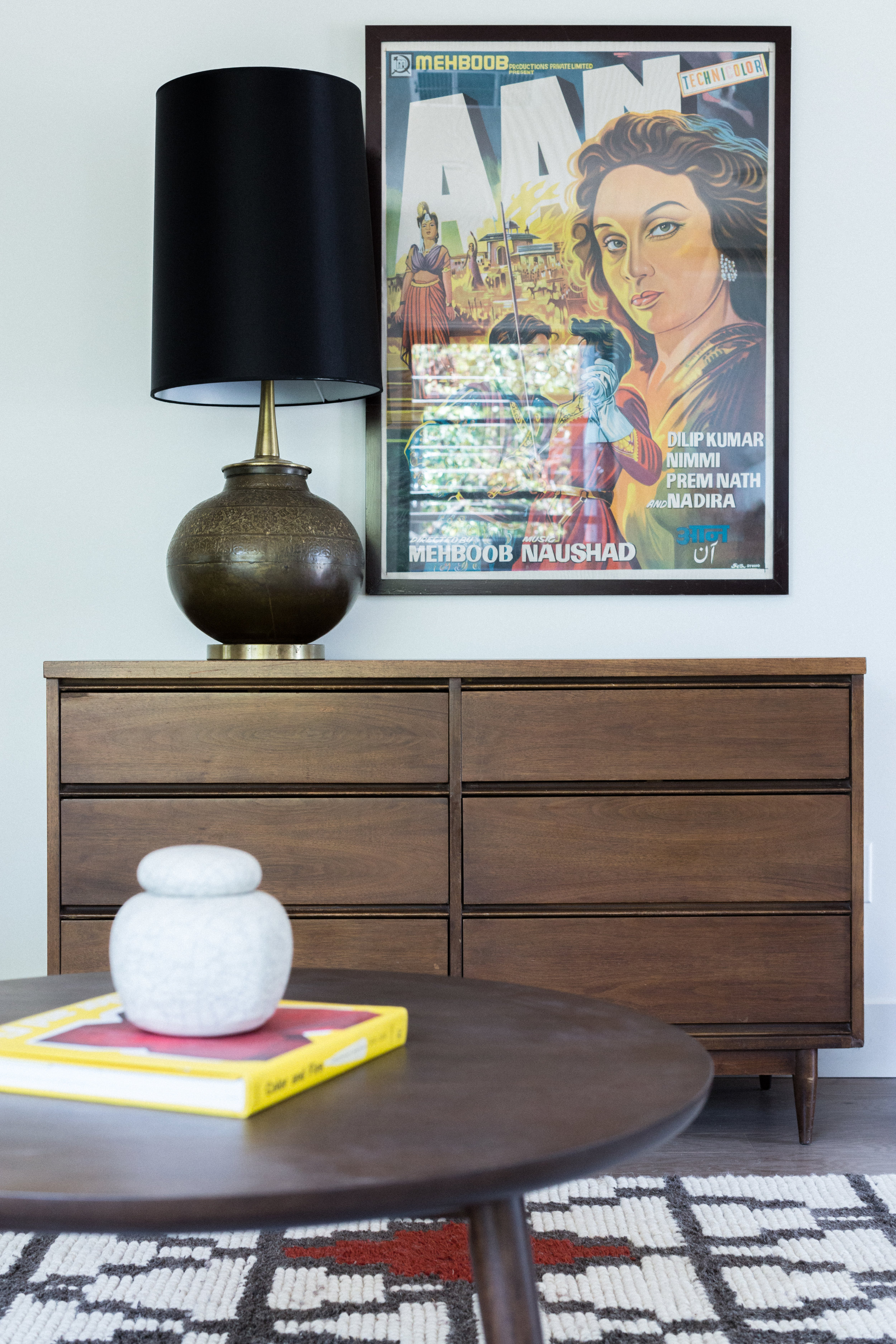 When you just happen to have an awesome vintage Bollywood poster, you just have to use it. Especially when it picks up on your colors. Below it, a vintage dresser (from craigslist, people!) we're using as a credenza, with a vintage brass lamp (thrifted!) and oversized black shade for drama.