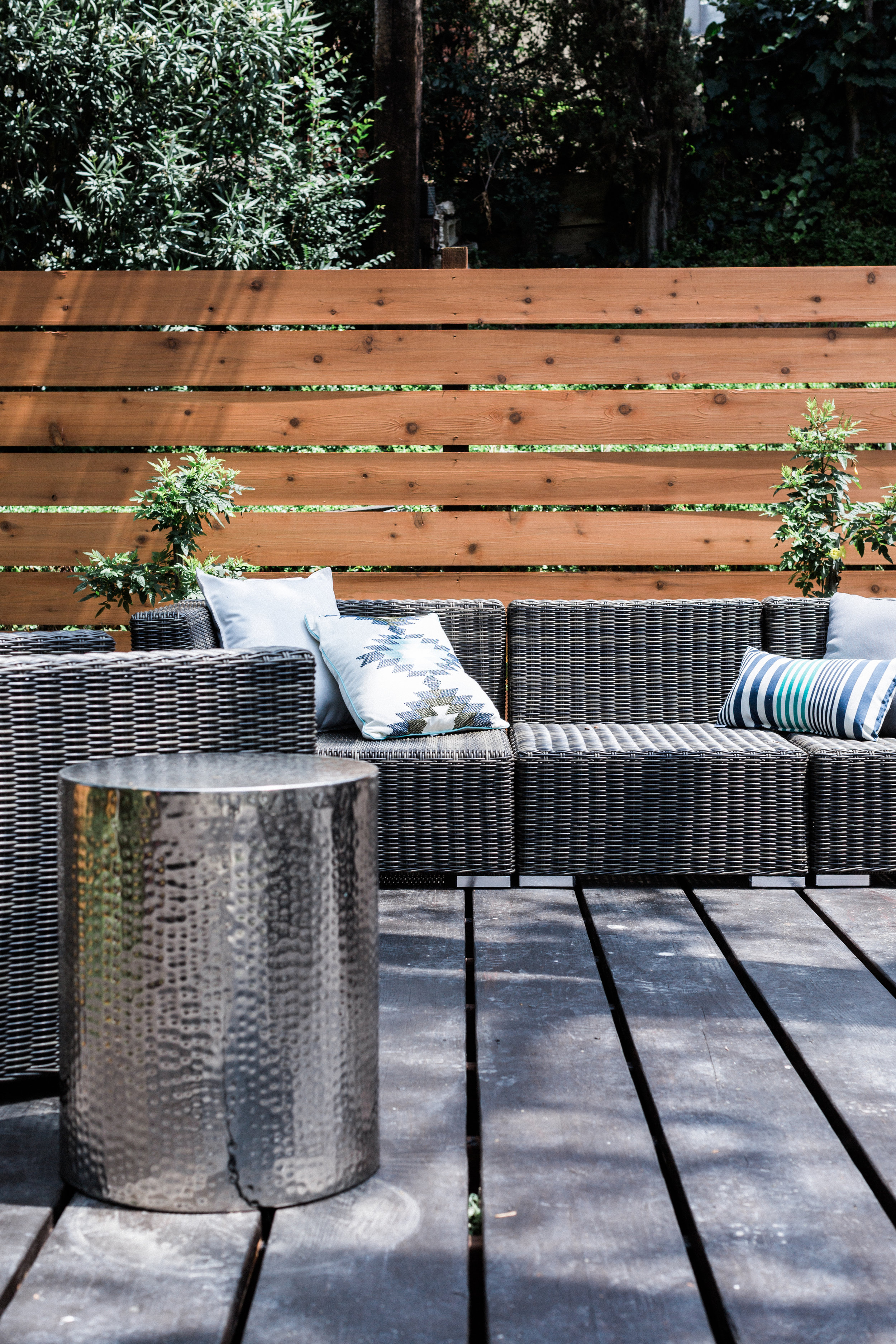 The awesome backyard deck is made even more welcoming with a sectional sofa.