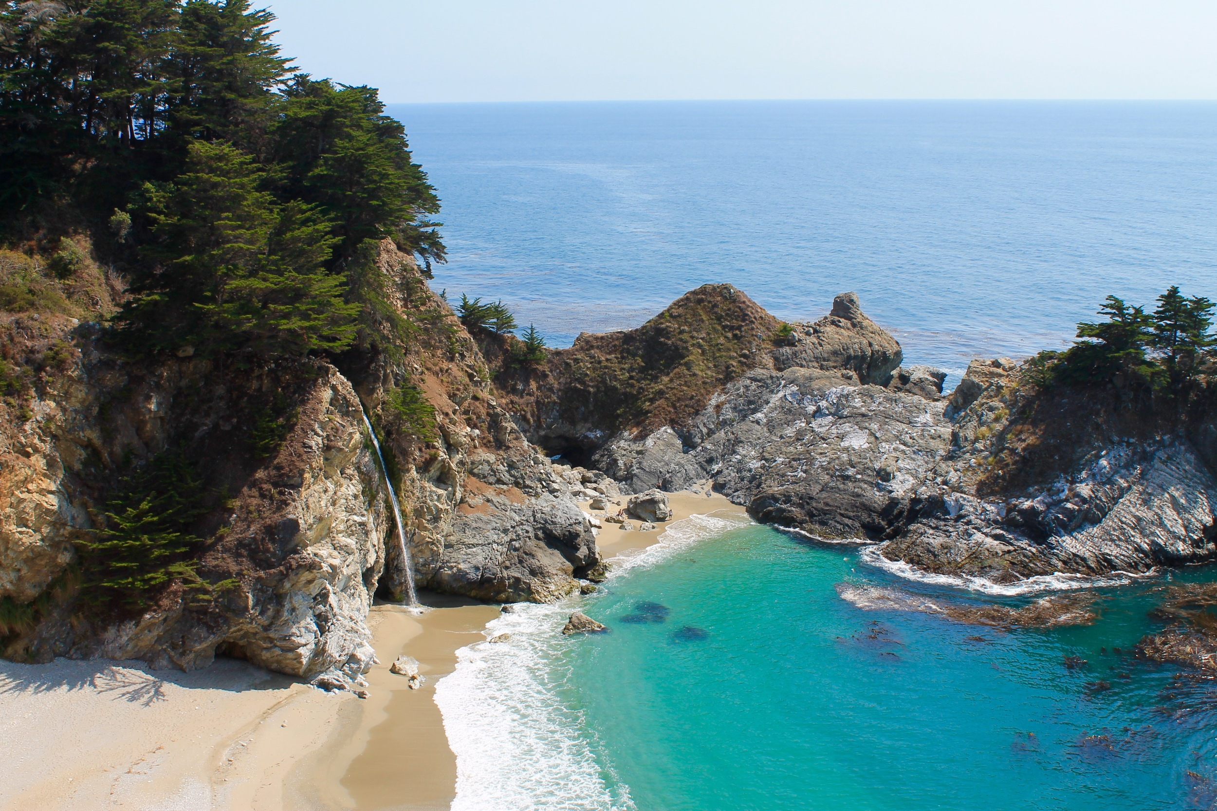 McWay Falls cascades straight into the ocean at high tide.  Yes the water really is that blue!