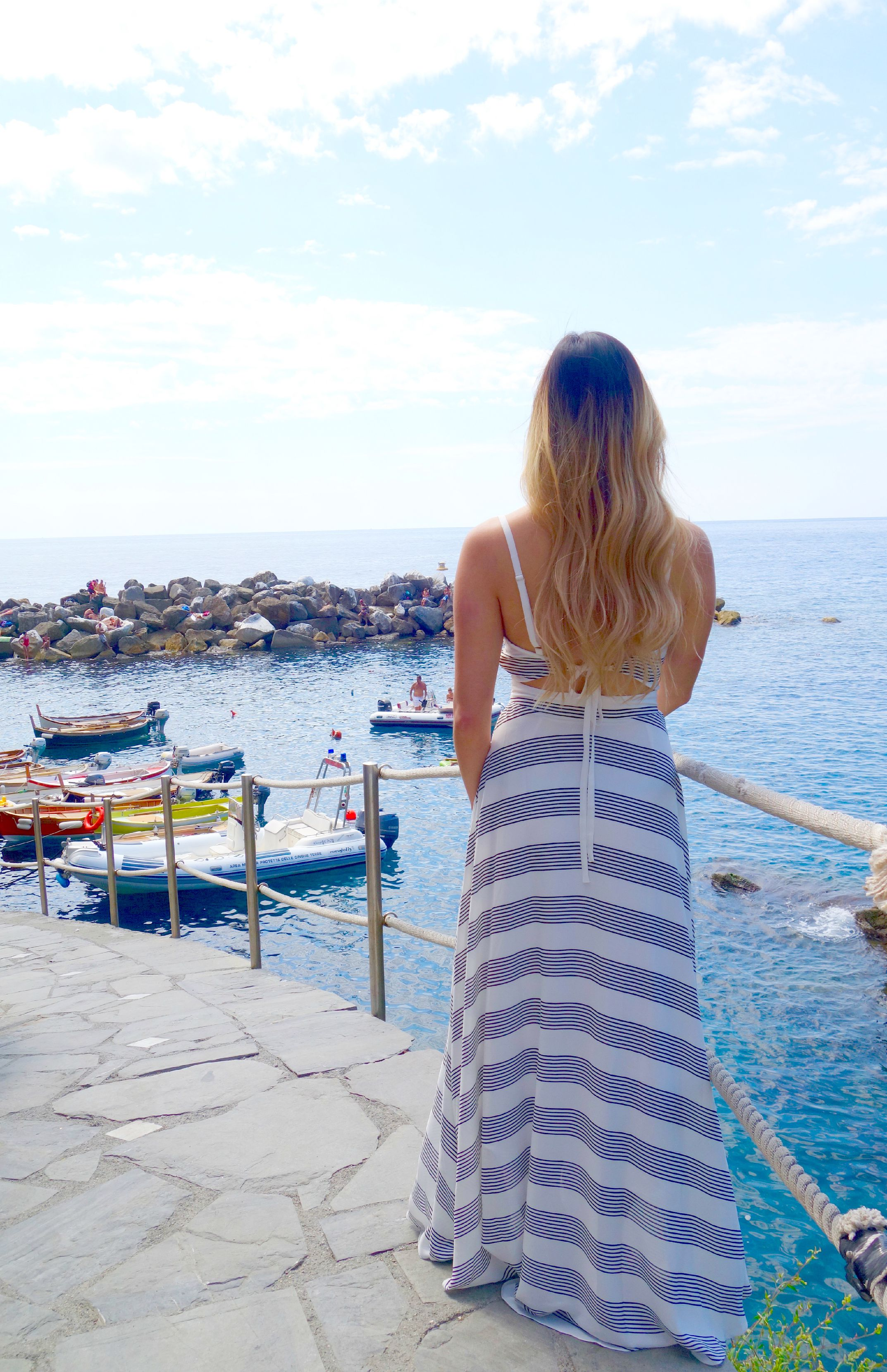 overlooking the water in manarola, wearing a dress by lucy paris.