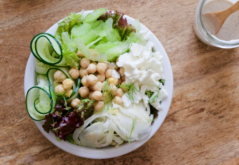 green salad with fennel, celery, chickpeas, cucumber and feta