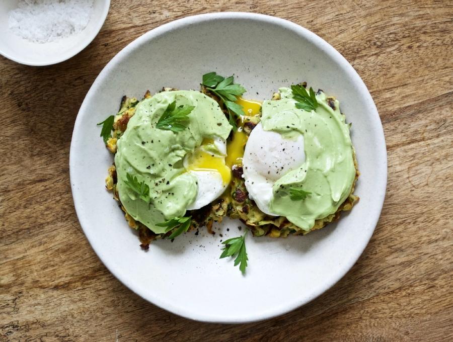 zucchini fritter eggs benedict with avocado crema