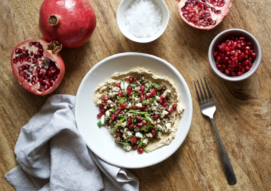 festive lentil quinoa salad with hummus and pomegranate seeds