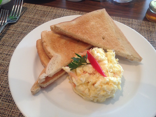 Salmon scrambled eggs & toast @ the grillroom in fiesta residences