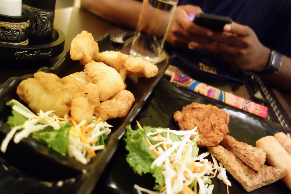 The calamari tempura is the puff puff looking thing on the left
