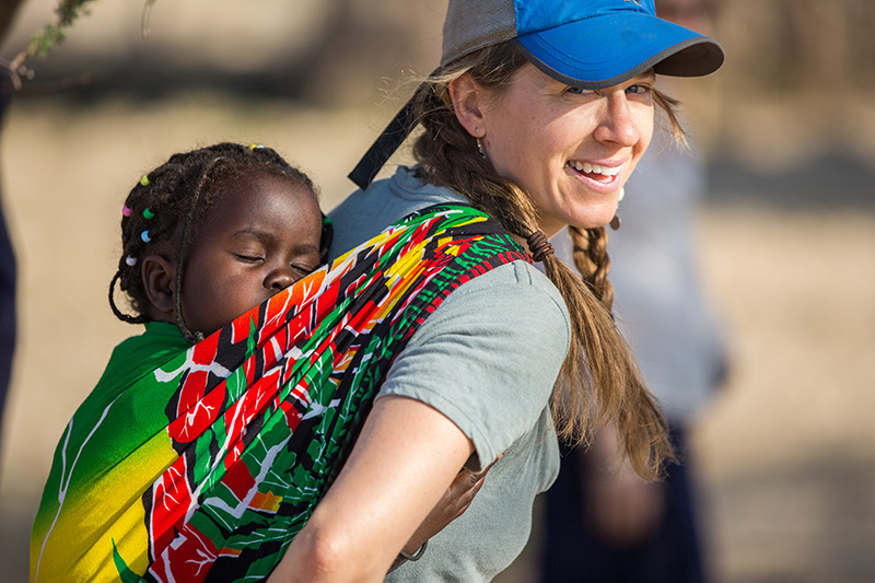 This winter I had the honor of co-leading a volunteer trip to Kenya through Colorado State University's Alternative Breaks program. This was my fifth time in Samburu, Kenya and each time my heart overflows with appreciation, love, laughter and strength that just radiates from the women and youth at  Unity Village  and the surrounding community. Here I am with little Karina, who's about 3 now. Interested in learning how educating young women and men can change a community for the better? Ask me about the  Samburu Youth Education Fund , a non-profit run for the community, by the community.