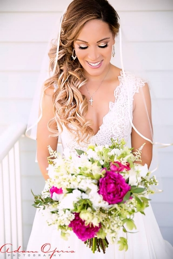 """I had Jessica do my hair for my wedding without a trial since I was traveling from FL to NY for a destination wedding. I could not have been more pleased with her work. She exceeded my expectations and my hair looked amazing all day for my wedding. Thank You so much and I highly recommend her and Bridal Rush for any hair needs."" -Christina"