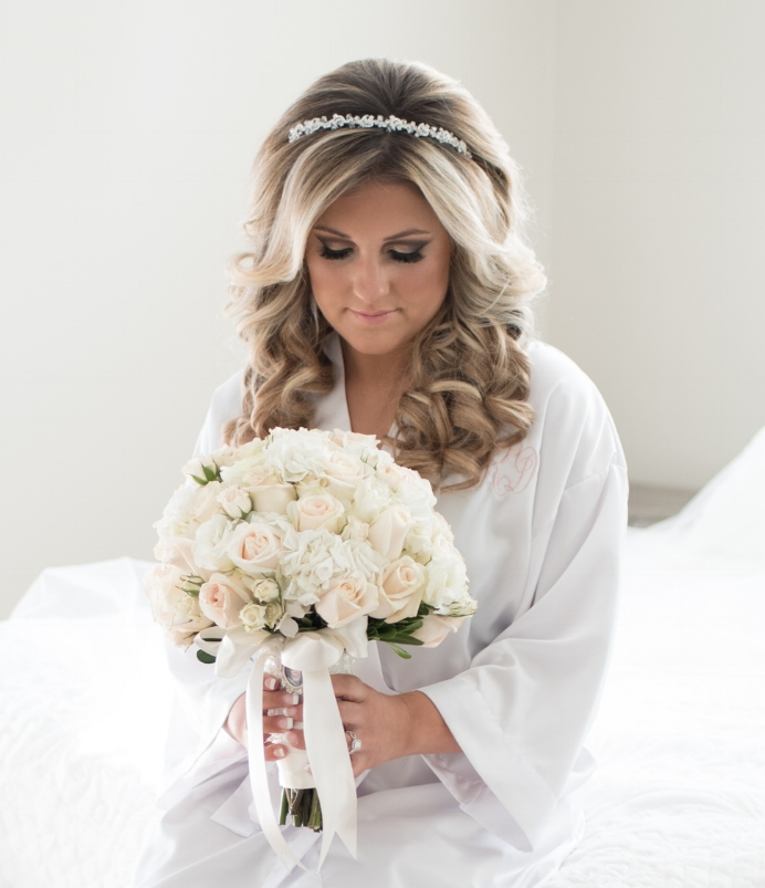 """I used Bridal Rush for my girls and I on my wedding day, November 17, 2017. I cannot say enough incredible things about Bridal Rush! From the second her and her stylists entered my house they were an absolute pleasure and always had smiles on their faces. I have gotten my hair done professionally only a handful of times in my life and never truly loved it, so I was nervous. I always felt like I liked it better when I did my own hair for certain occasions and events. However, this totally changed when Jessica, the owner of Bridal Rush, styled my hair on my wedding day. It was absolutely beautiful. Everything I could have imagined and more! She allowed me to use my extensions and she blended them so seamlessly into my hair that no one could tell I was wearing them. She also gave me the opportunity to look at my hair throughout the time she was doing it to make sure I liked it and make any changes as she went. She truly cared about me and what I wanted. Generally, my hair falls pretty quickly and it is hard to keep a curl in my hair for a couple of hours let alone for 12. My hair not only stayed, but looked almost as perfect as it did in the morning, even after I danced the night away. Jessica made me feel very special and so beautiful! Her team also made my girls look and feel amazing as well. They were an extremely talented, artistic, friendly, and professional group of women. Their passion for what they do shines through their beautiful work and how they treat their clients. I highly recommend Bridal Rush to all brides!""  -Samantha"