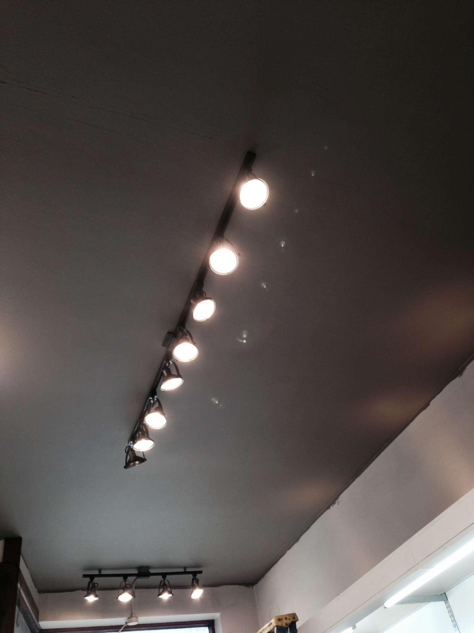 the new lights and the ceiling paint! loving the warm feeling you get from just these two changes!