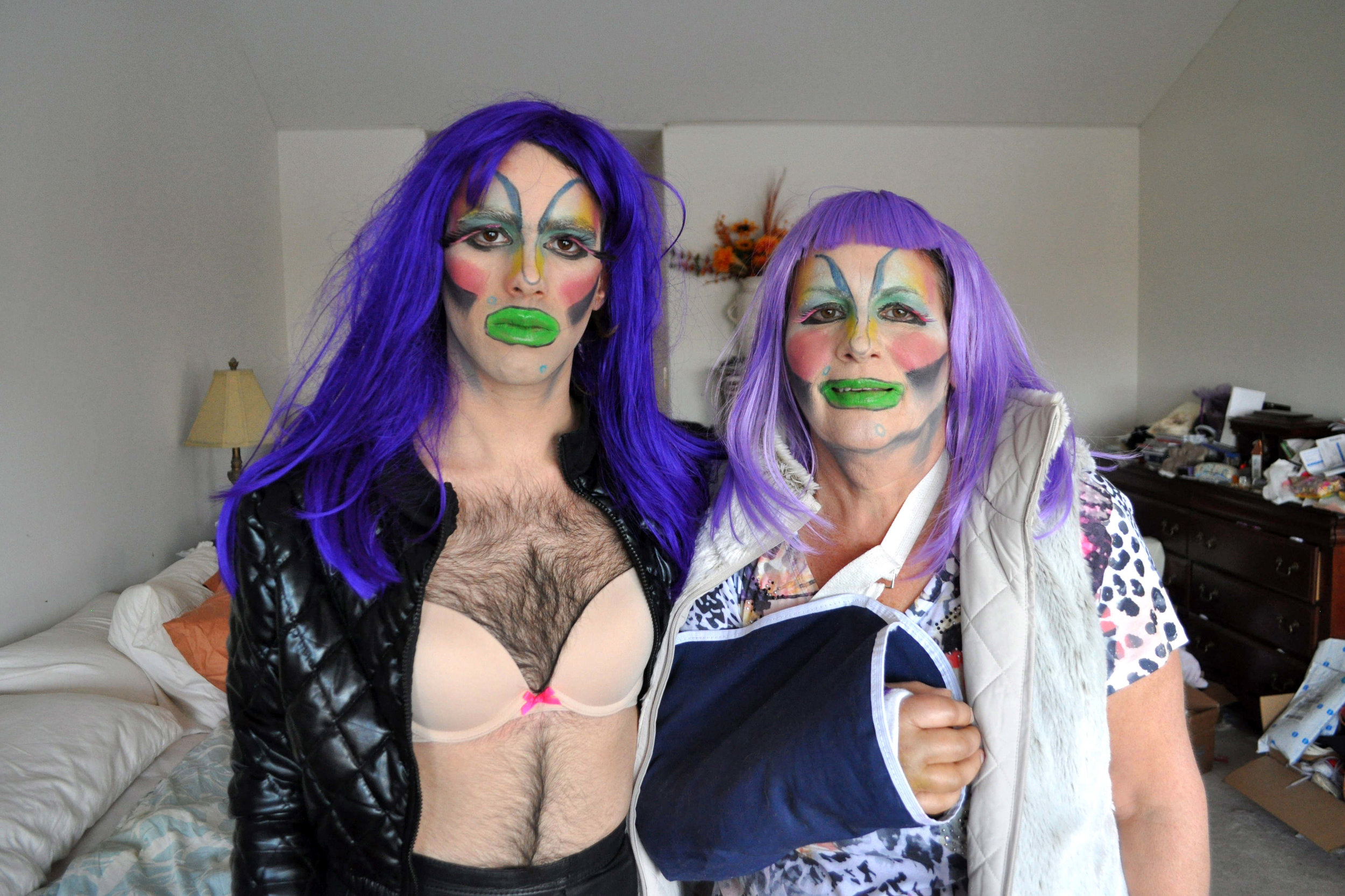 """A still from Local's BFA thesis film, 'Year of Whore.' """"In this scene, I dress my mom and I up in purple-haired mother/daughter drag."""""""