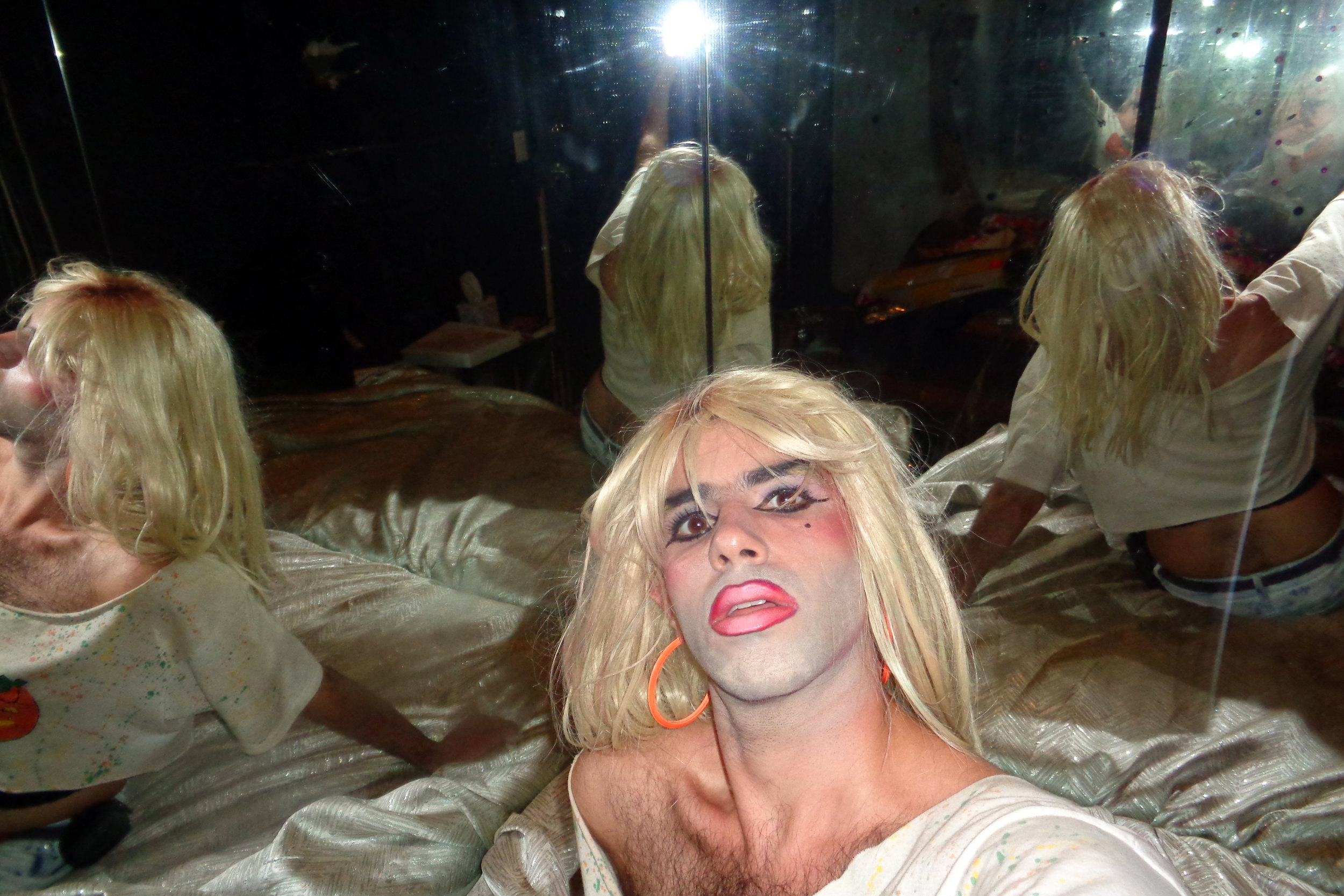 """A selfie taken backstage at the former venue, The Spectrum. """"I like the depiction of fractured selves in the dirty mirror, the glow of the point-and-shoot flash, and my heavy liner/gradient lip look."""""""