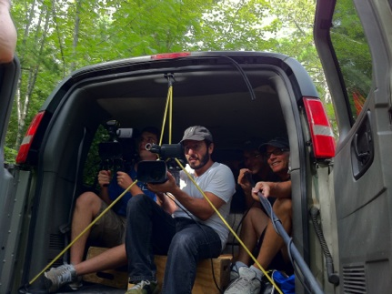 setting up a tracking shot from a van. In the picture from left to right.   Dillon Ward,   Ezra Bookstein,   Me (in the shadows directing),   Peter Markle, our teacher (booming for sound)