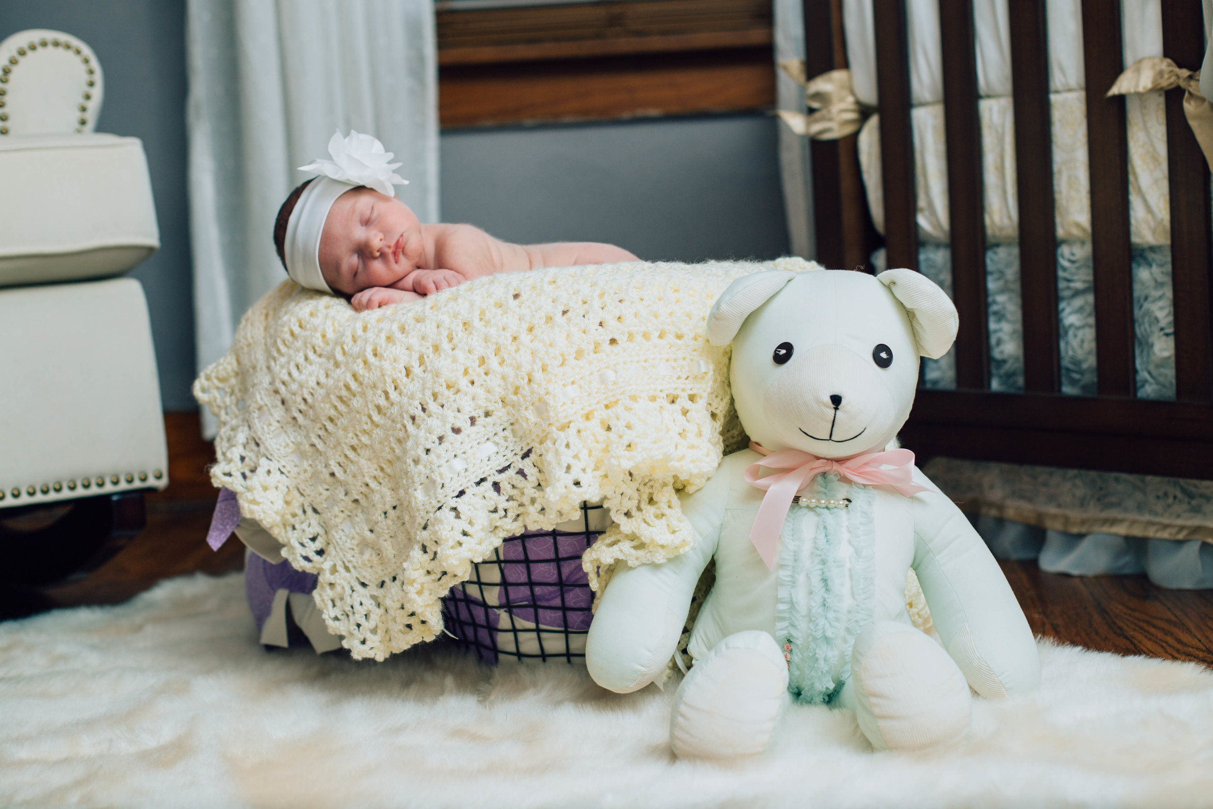 I love featuring homemade gifts and family heirlooms in newborn photos. This bear was actually made for her Grandmother many years ago. It is in pristine condition. The blankets are all handmade gifts. SO special!