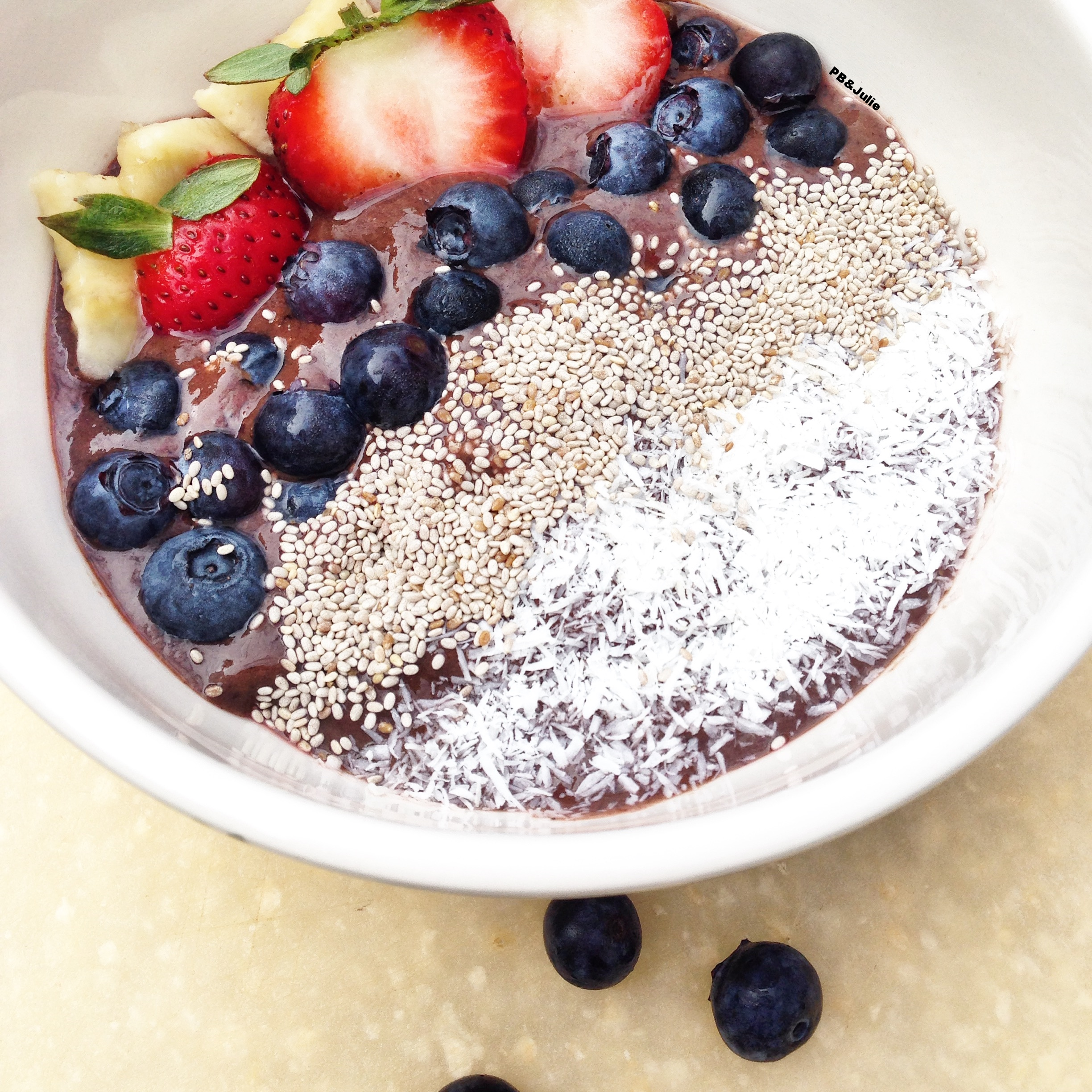PB&Julie's Mango Acai Bowl with fresh organic berries, omega rich chia seeds and satisfyingly tropical coconut shreds. Love your body.