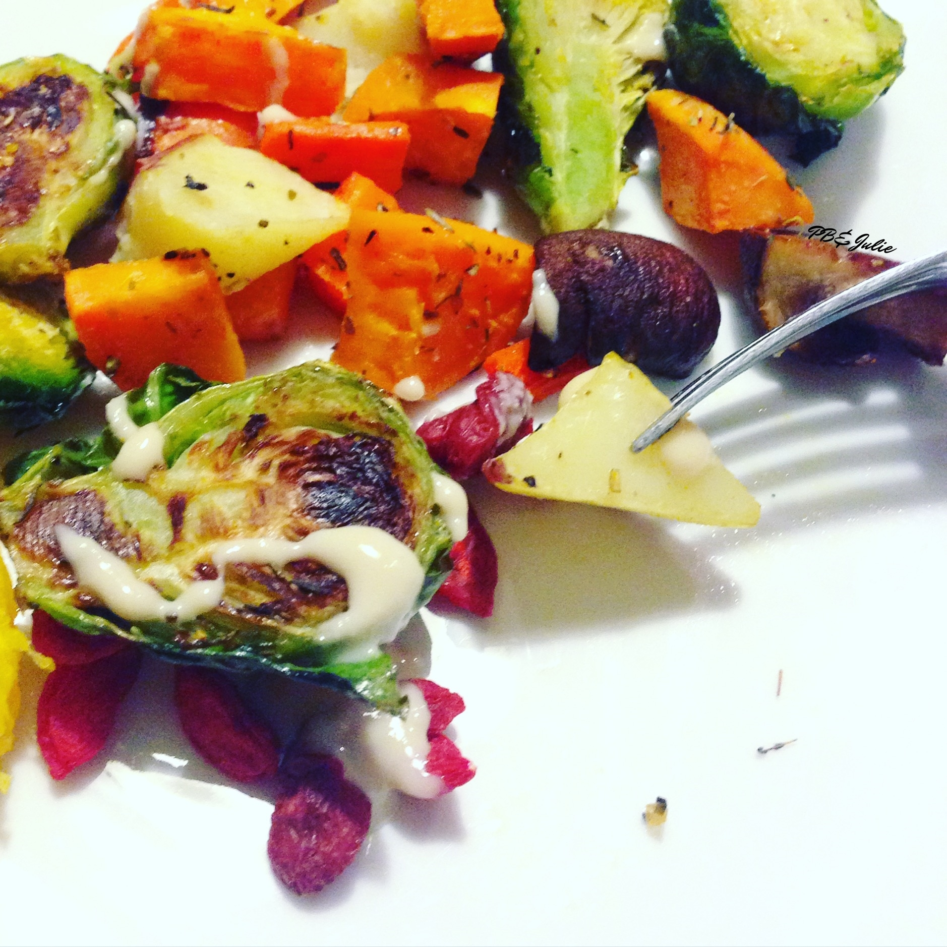 I spiced up my Easy Roasted Fall Veggies with goji berries and a raw tahini drizzle. Delicious! #vegan #thanksgiving #plantbased