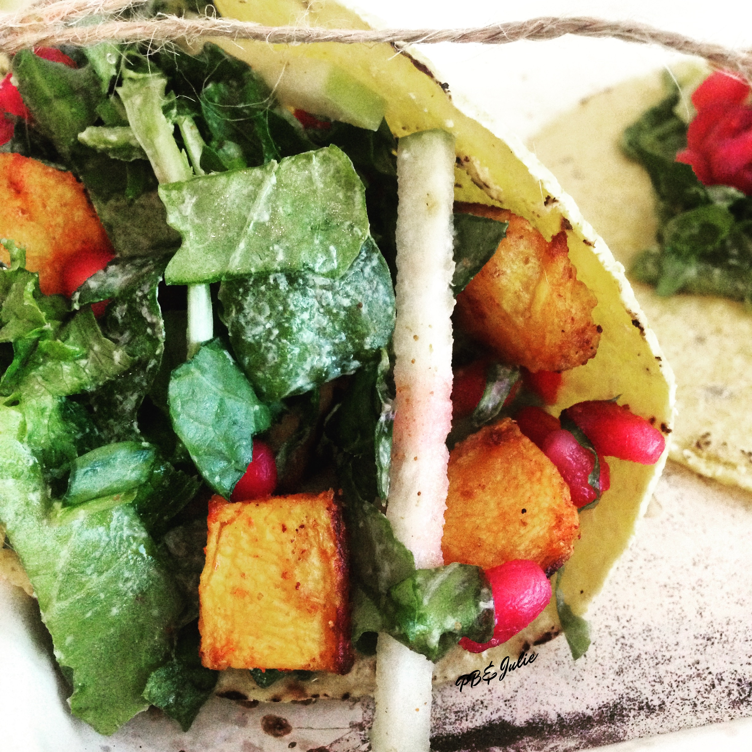 Spice up your next Taco Tuesday with these smokey, sweet vegan butternut squash and tahini kale slaw tacos with pomegranate avocado smash.
