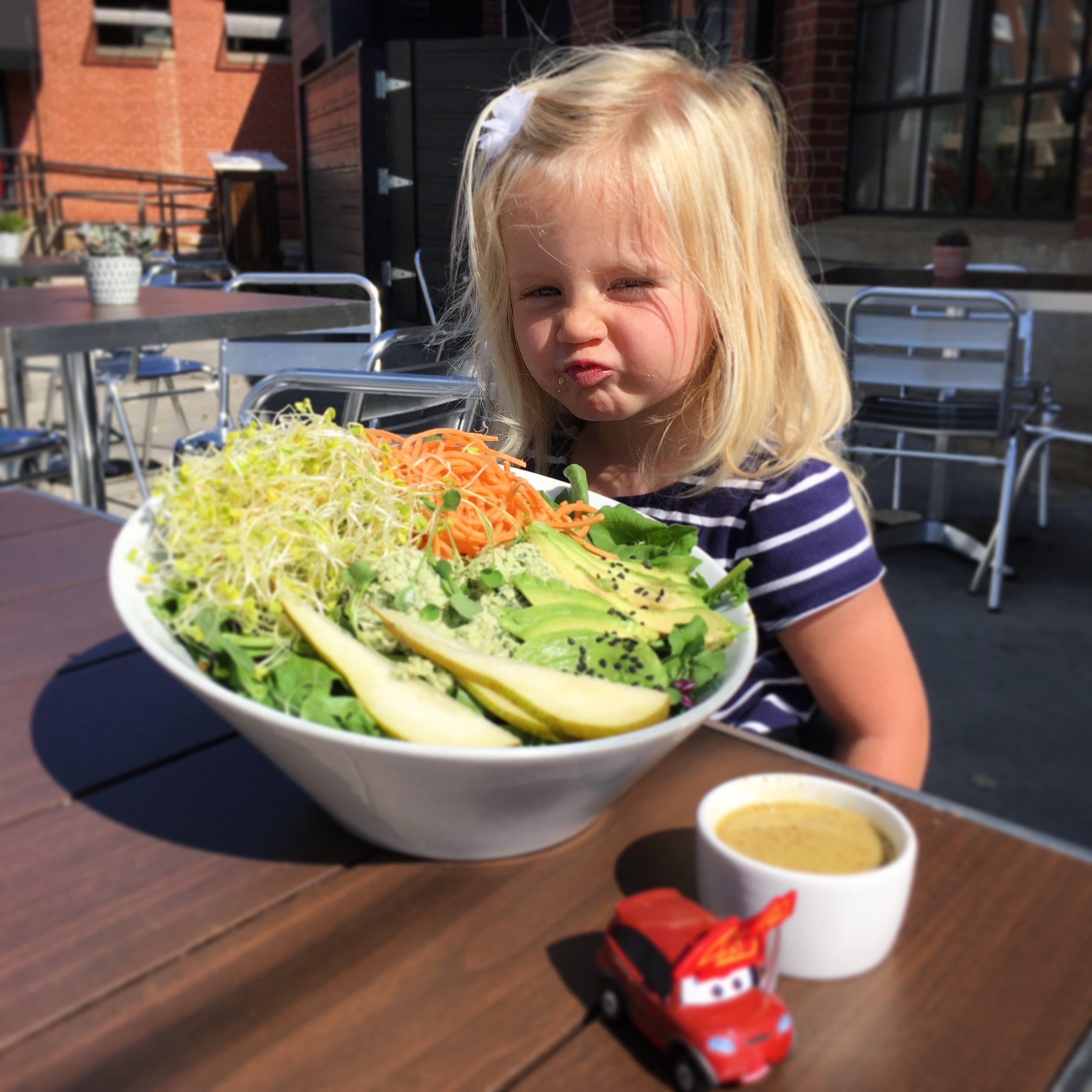 Always stealing Mommy's food #minime @livingkitchen Charlotte Arugula Harvest Salad