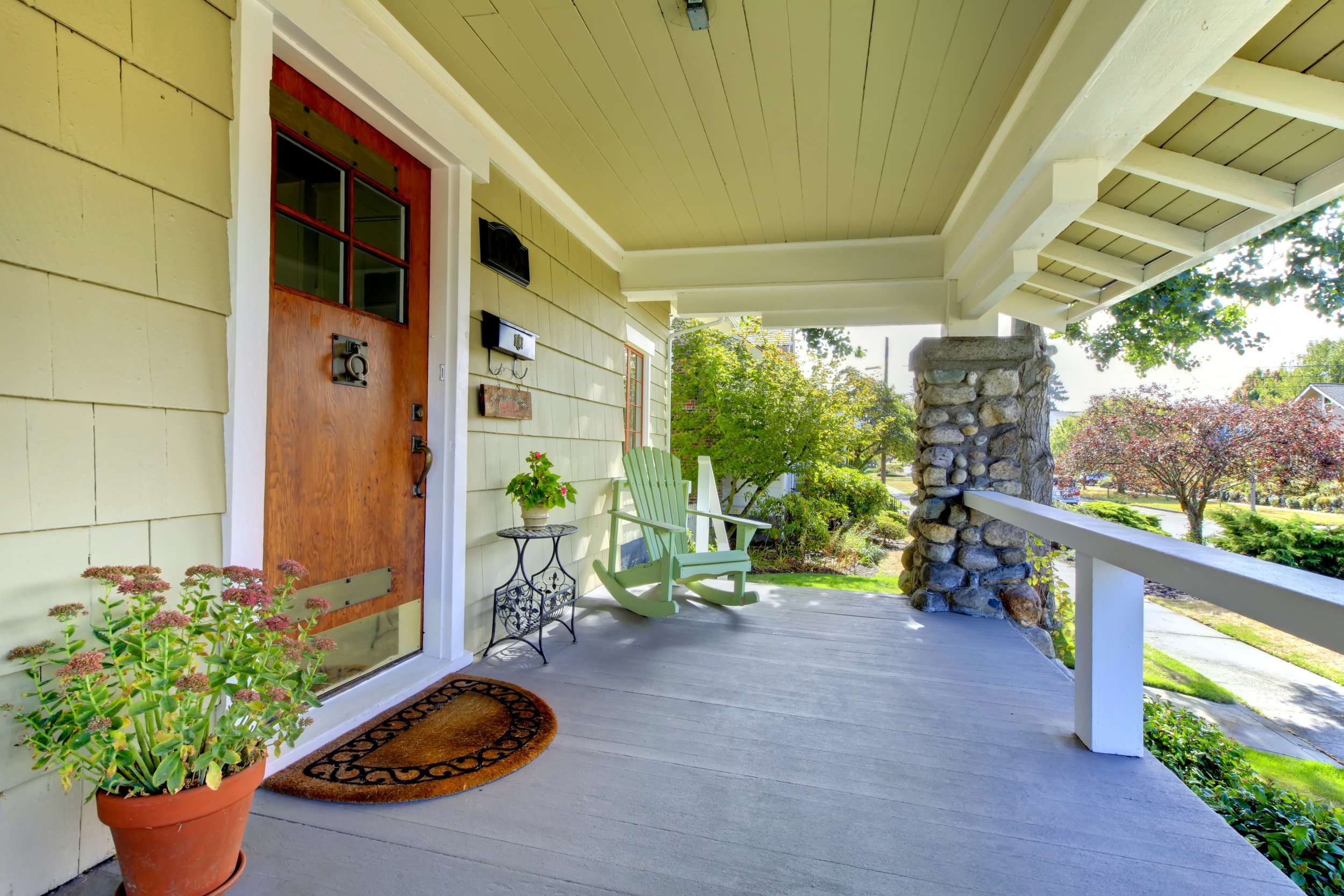 Covered front porch of theold craftsman style home.