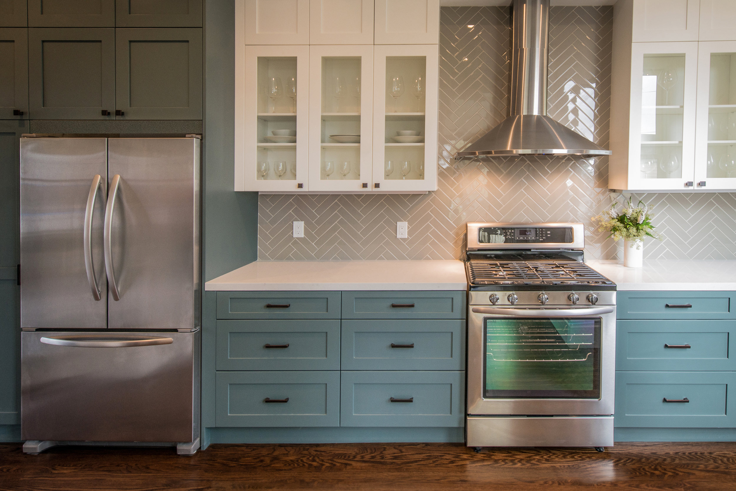 Modern Kitchen with Teal Base Cabinets