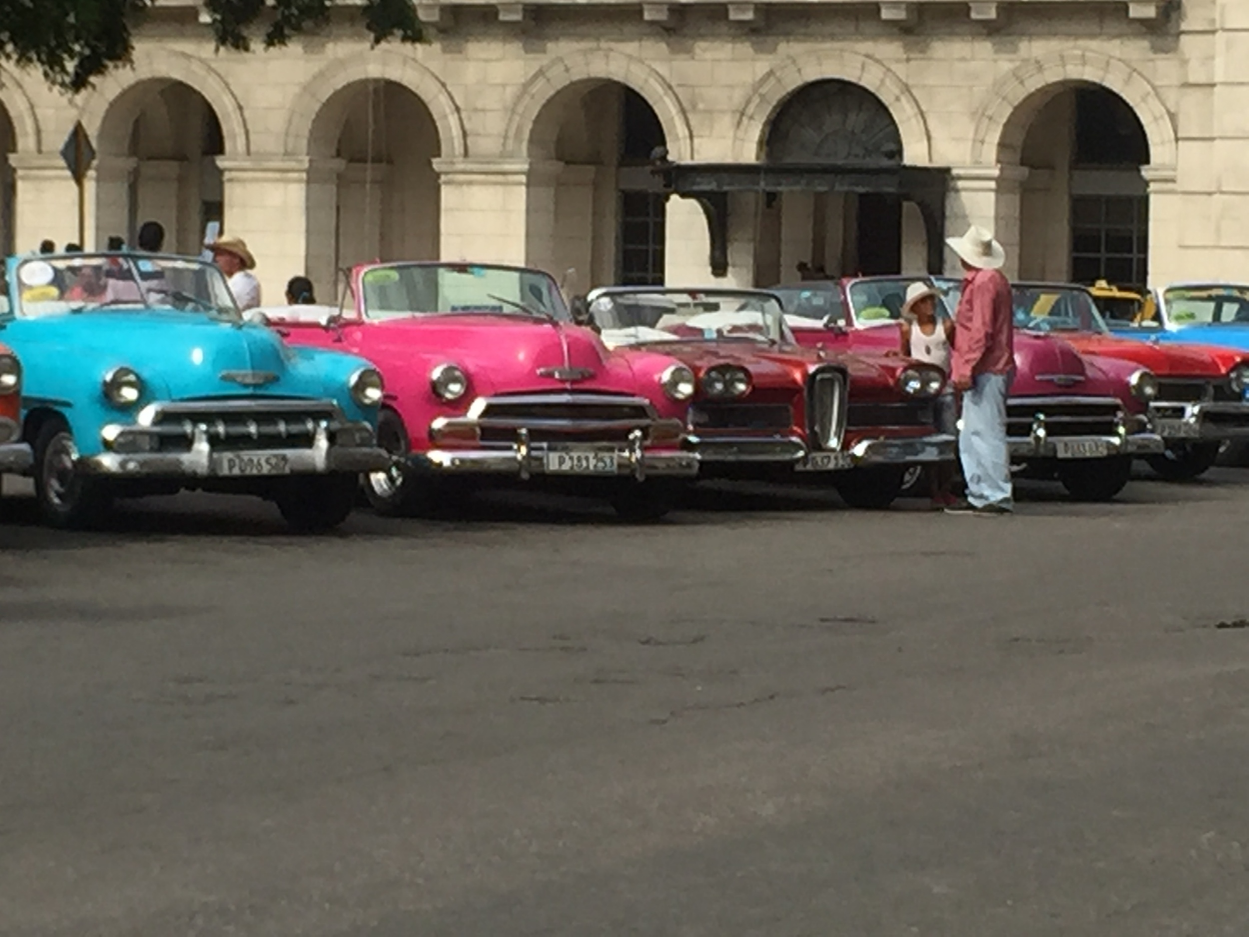 Classic cars taxis line up ready for tourists. For $30 you'll get an hour long tour through Havana.
